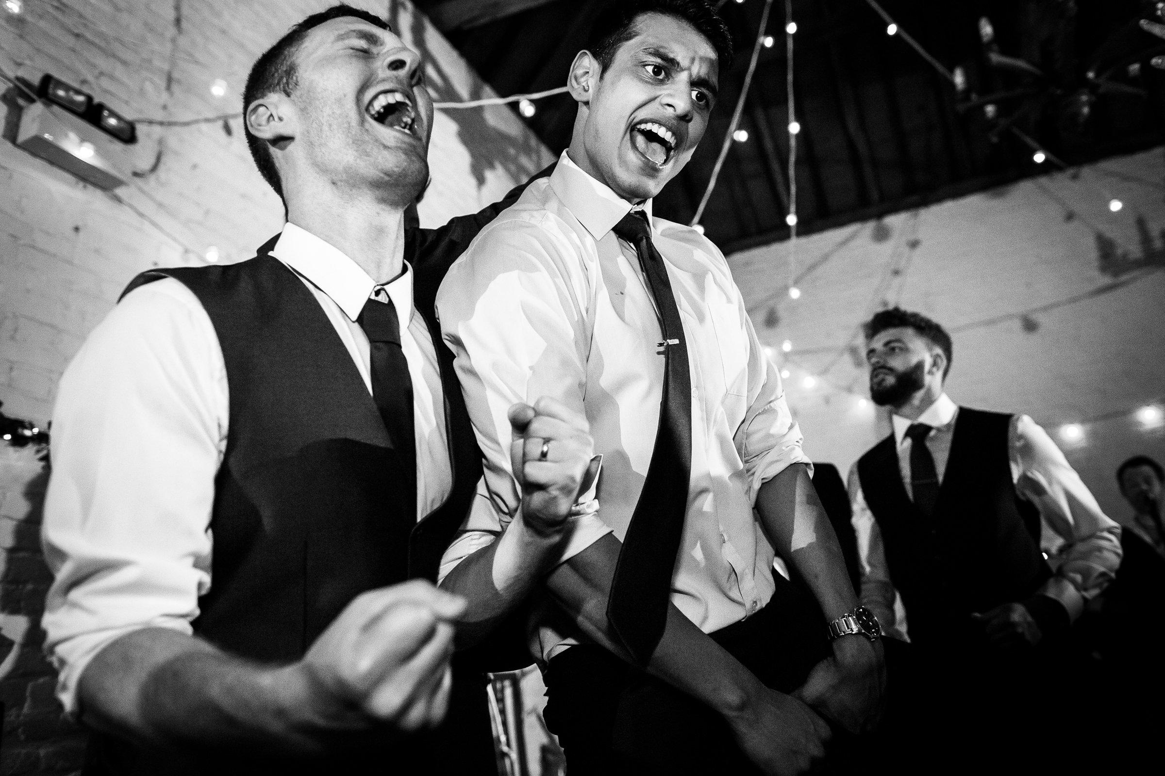 Fun dancing wedding photo