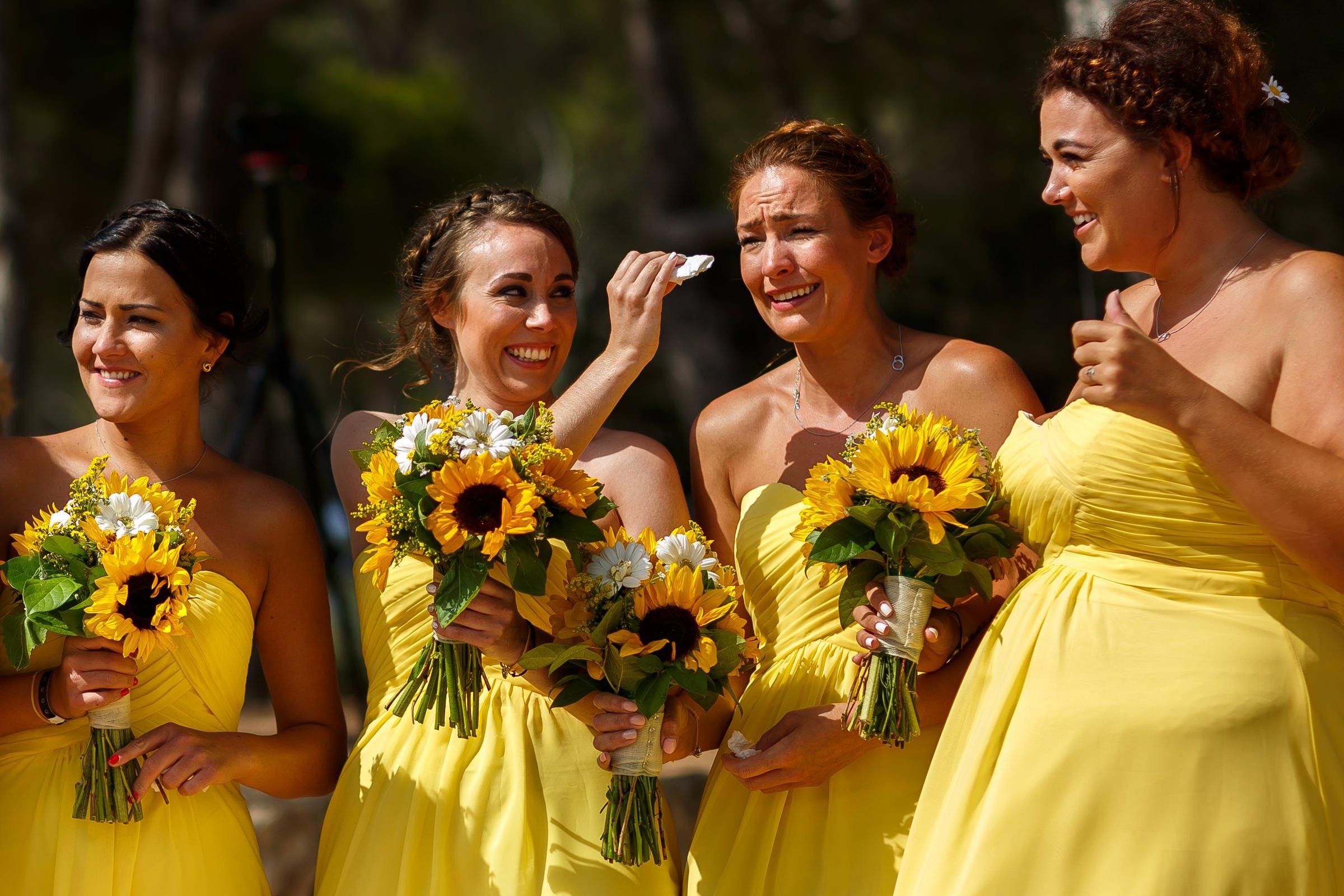 Natural photo of bridesmaids crying at wedding