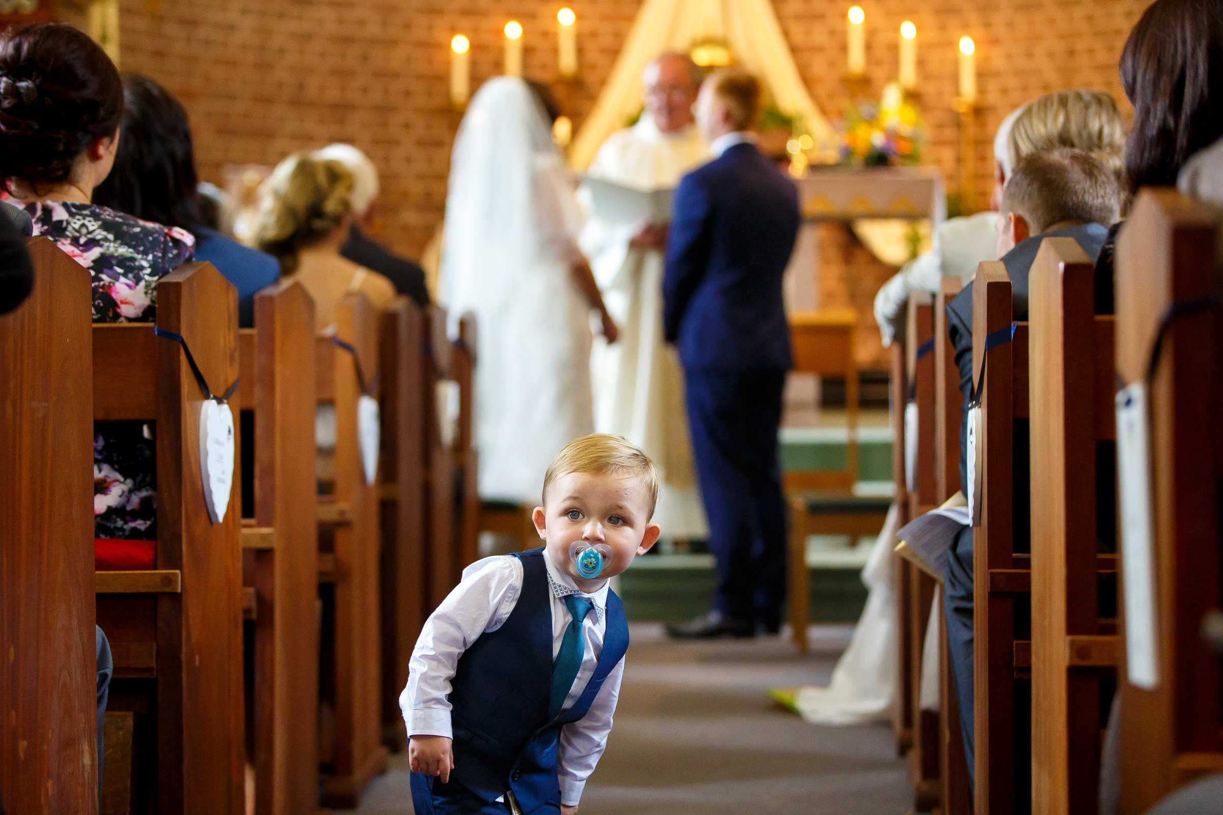 Funny photo of child at wedding