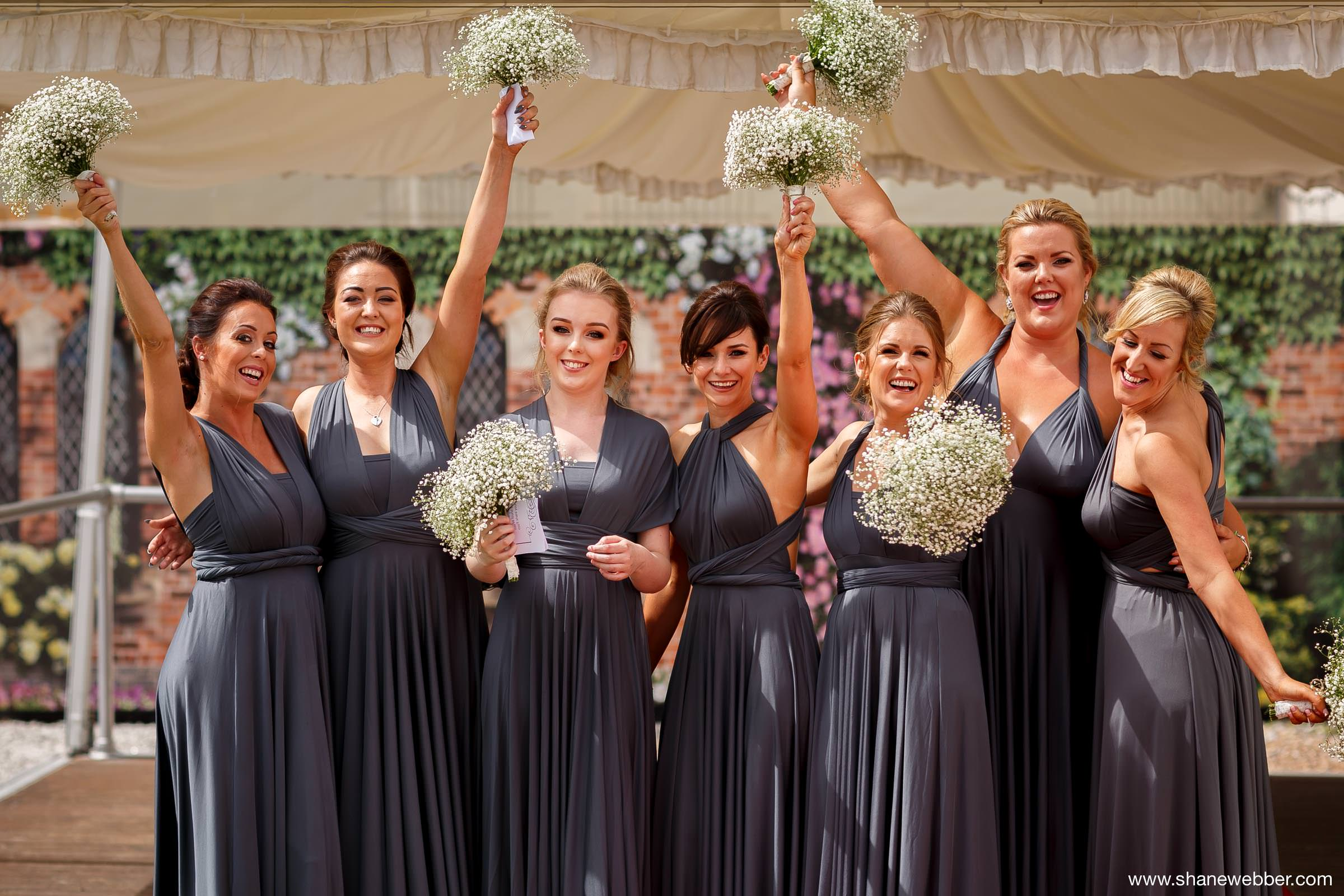 Bridesmaids in grey dresses at Gorton Monastery Manchester