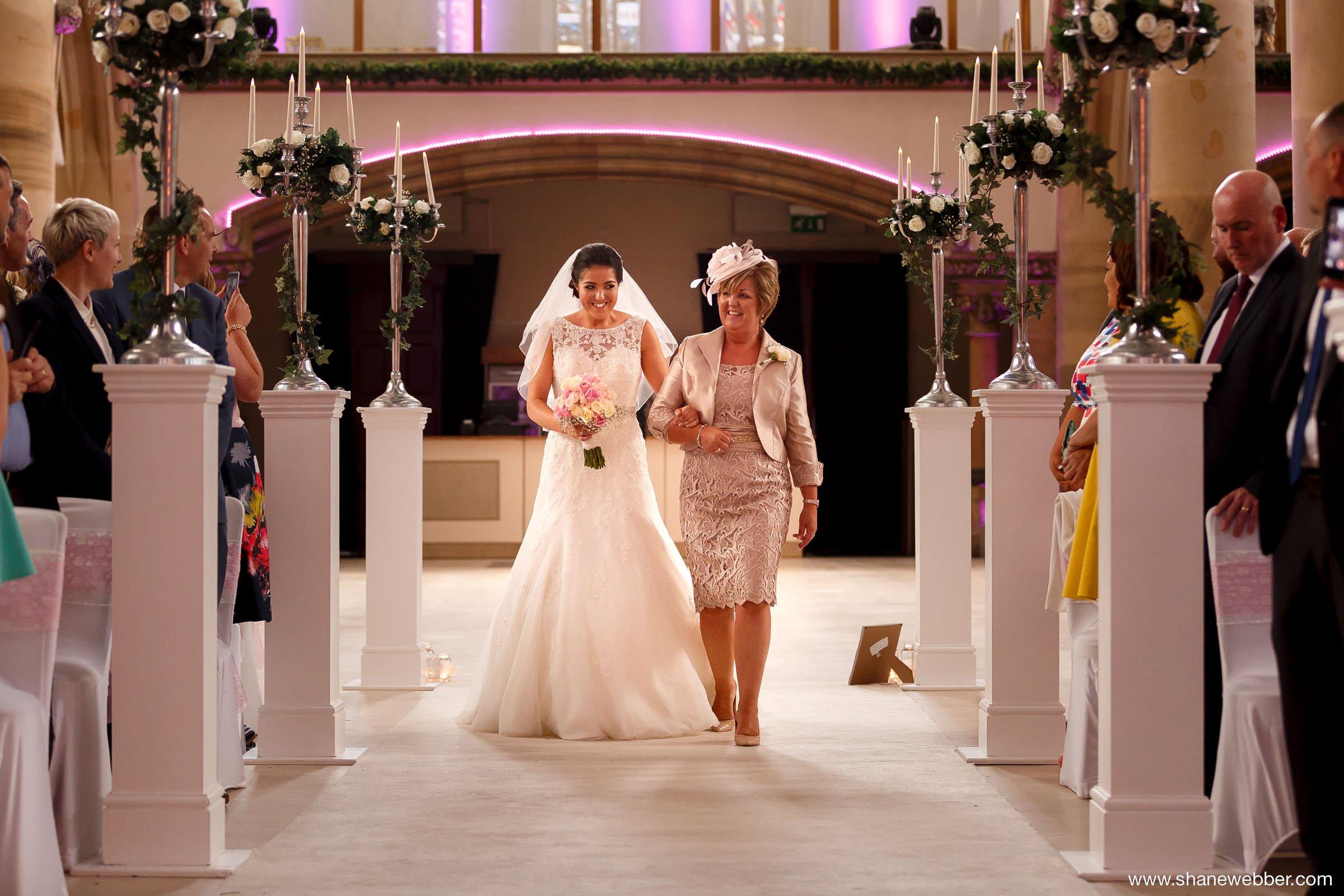 Bride walking down the aisle at Gorton Monastery Manchester wedding