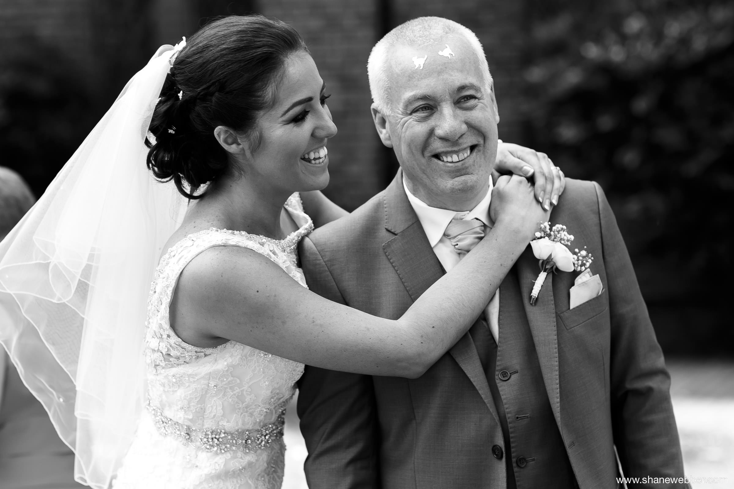 Black and white wedding photo of bride and Dad
