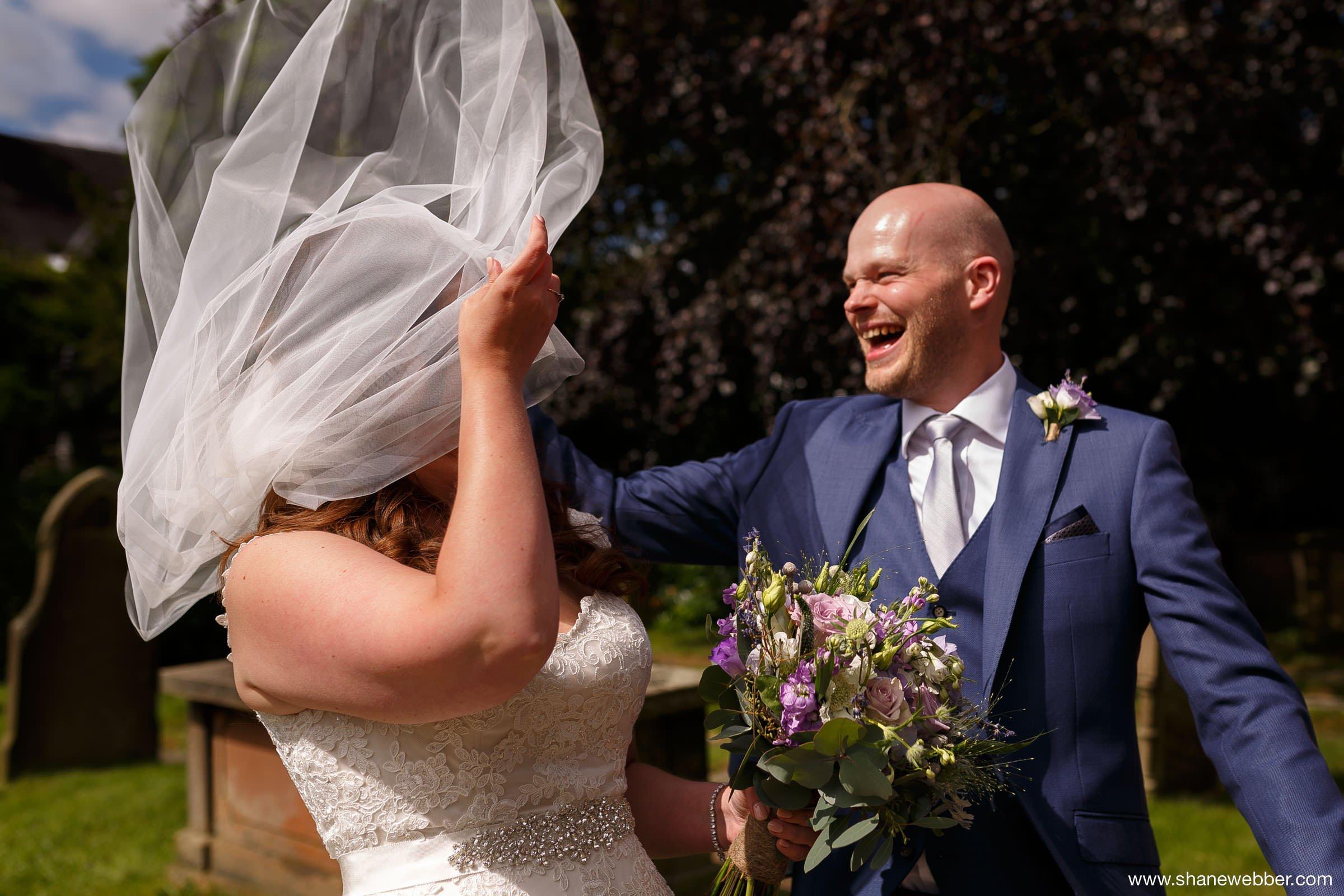 Funny wedding photo of bride and groom