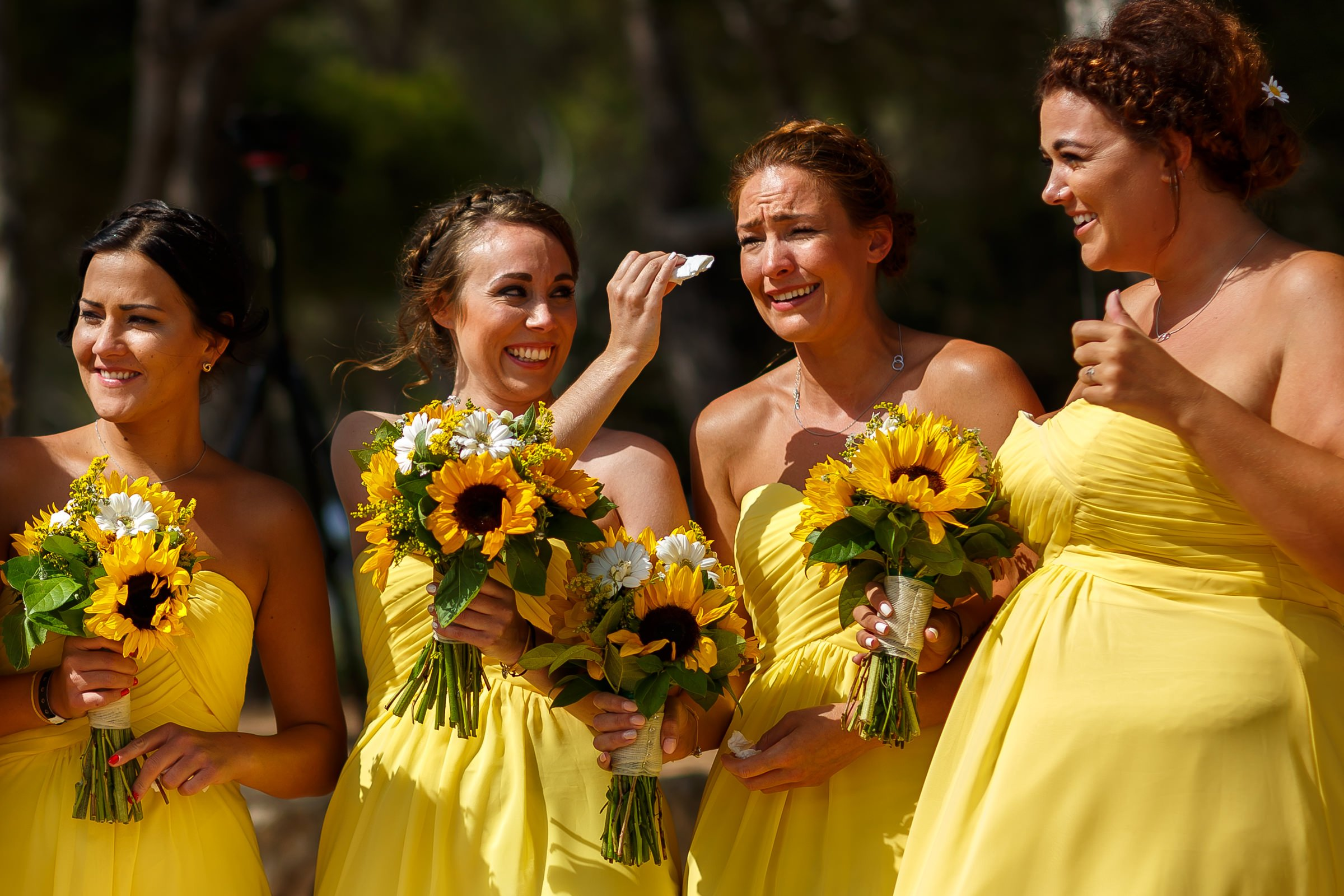 Natural photo of bridesmaids crying at wedding