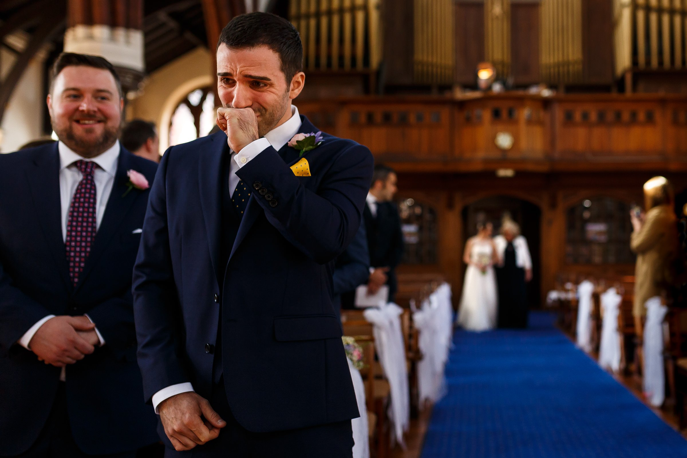 Crying nervous groom at wedding