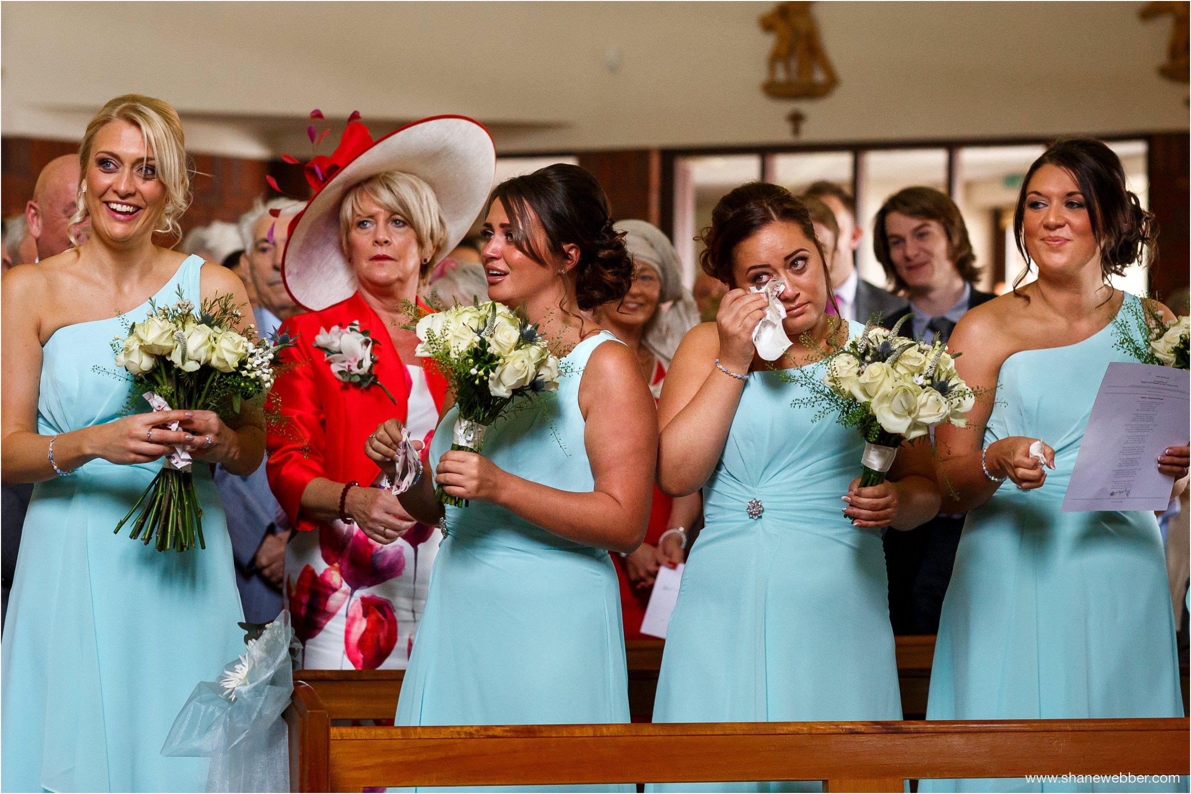 Bridesmaids crying at wedding