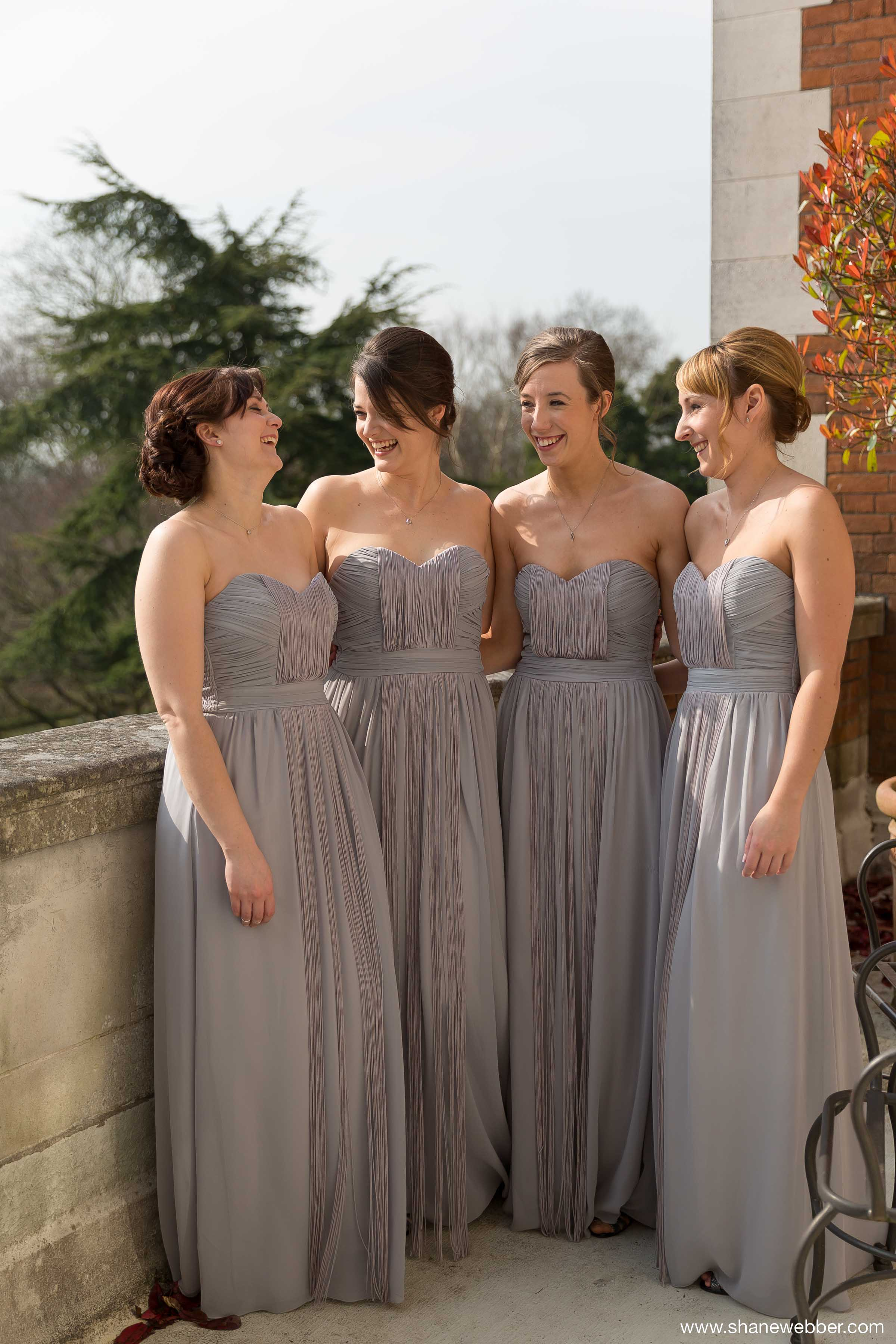 Bridesmaids in light grey dresses