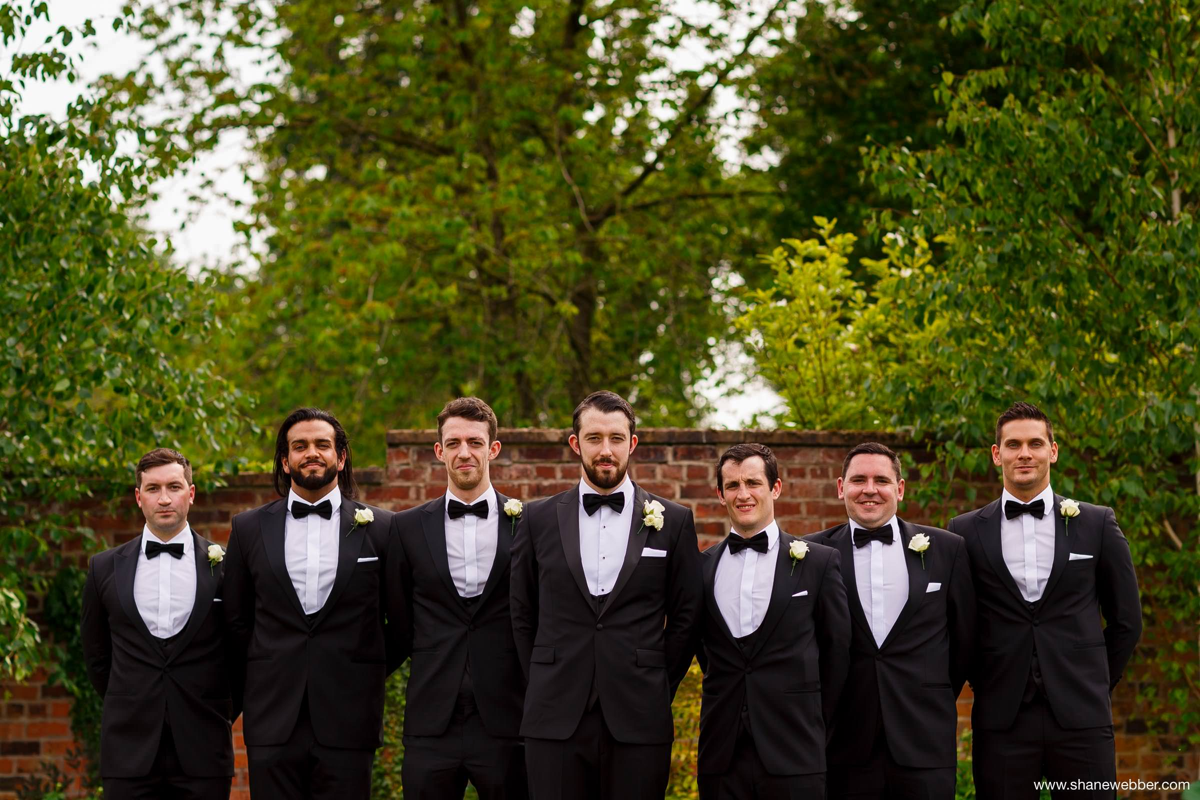 Groom and groomsmen wearing black tie