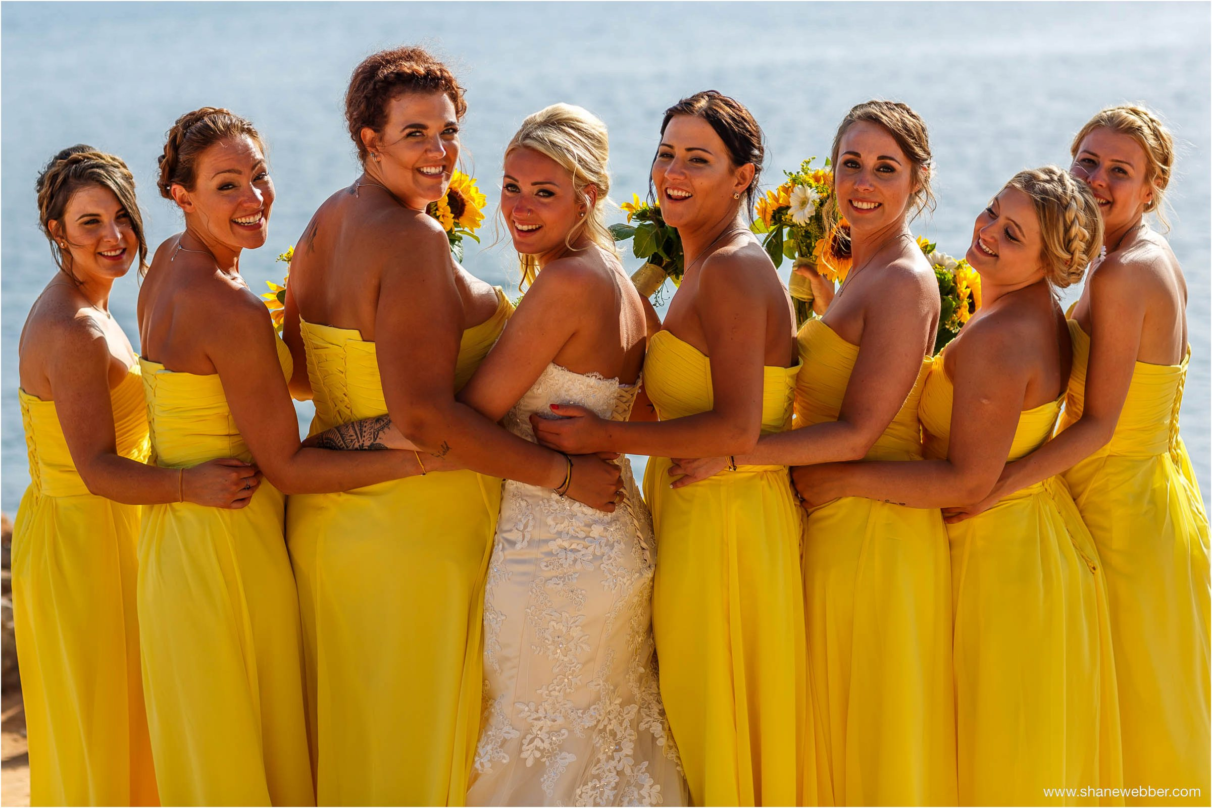 Bridesmaids in bright yellow dresses