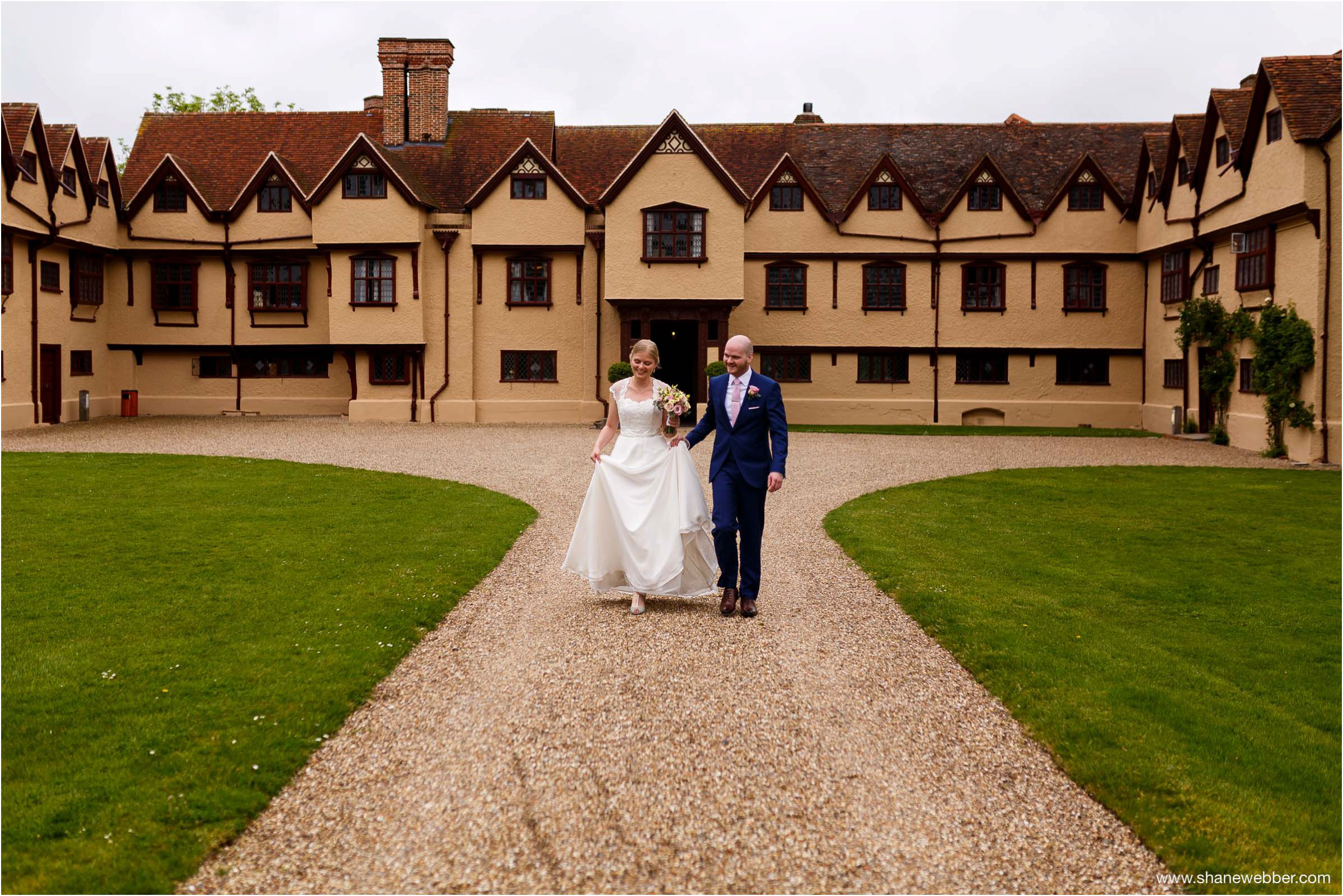 Bride and groom heading to Tithe Barn at Ufton Court