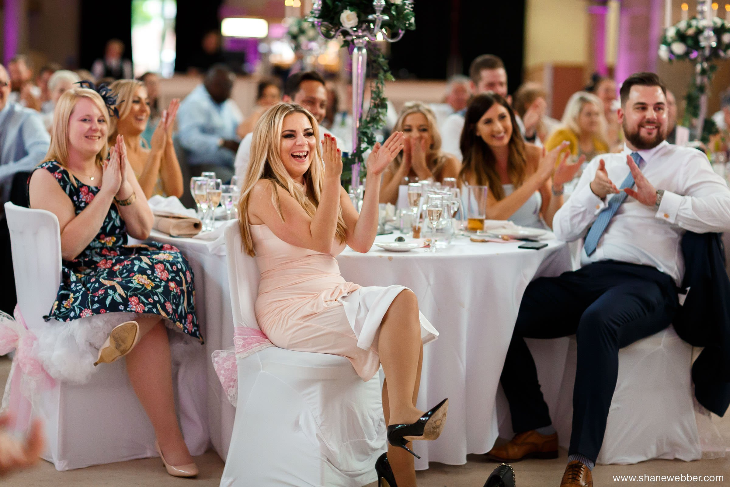 Guests reaction to funny wedding speeches