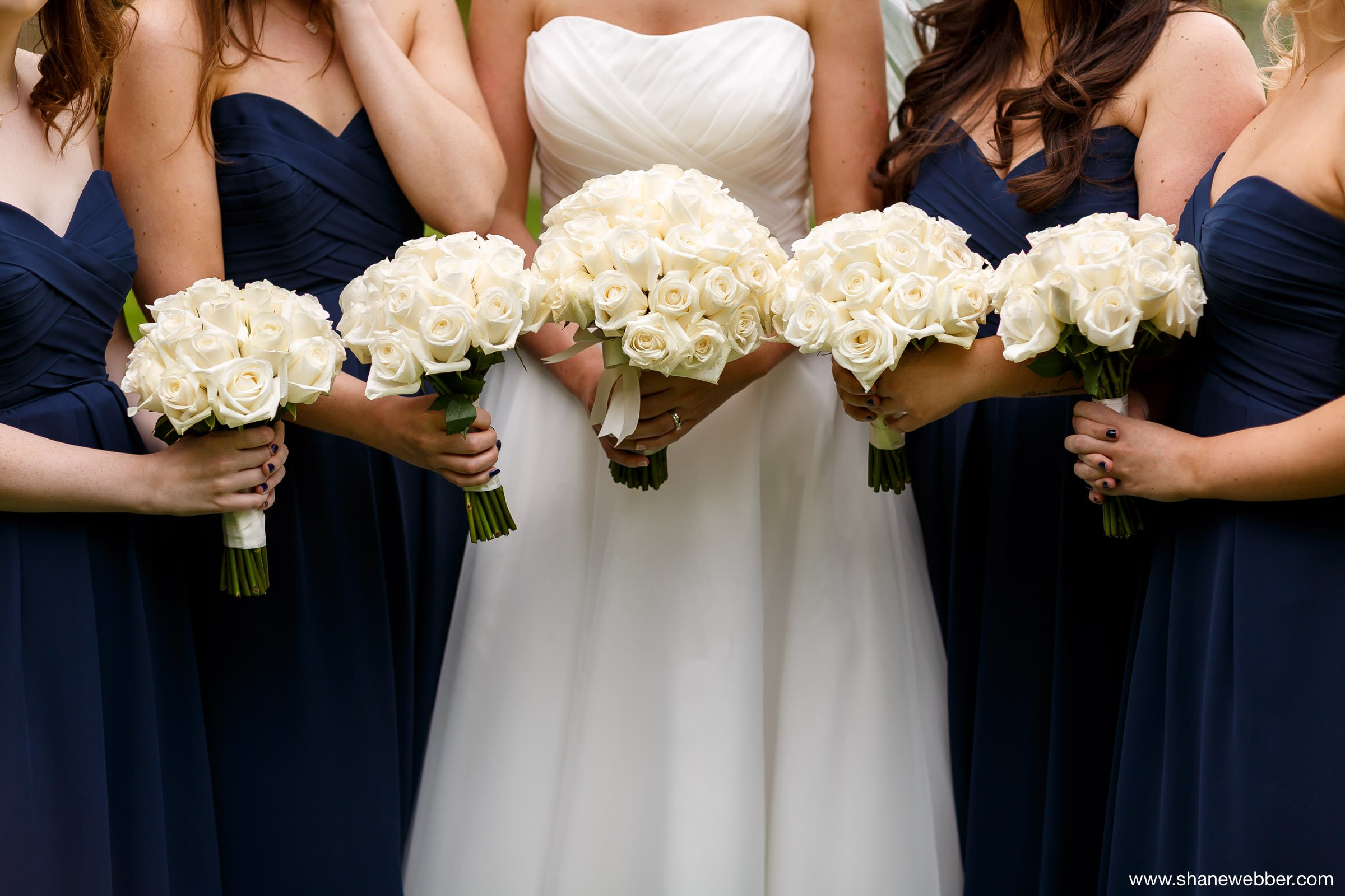 White rose bouquets at Grosvenor Pulford Hotel Chester wedding