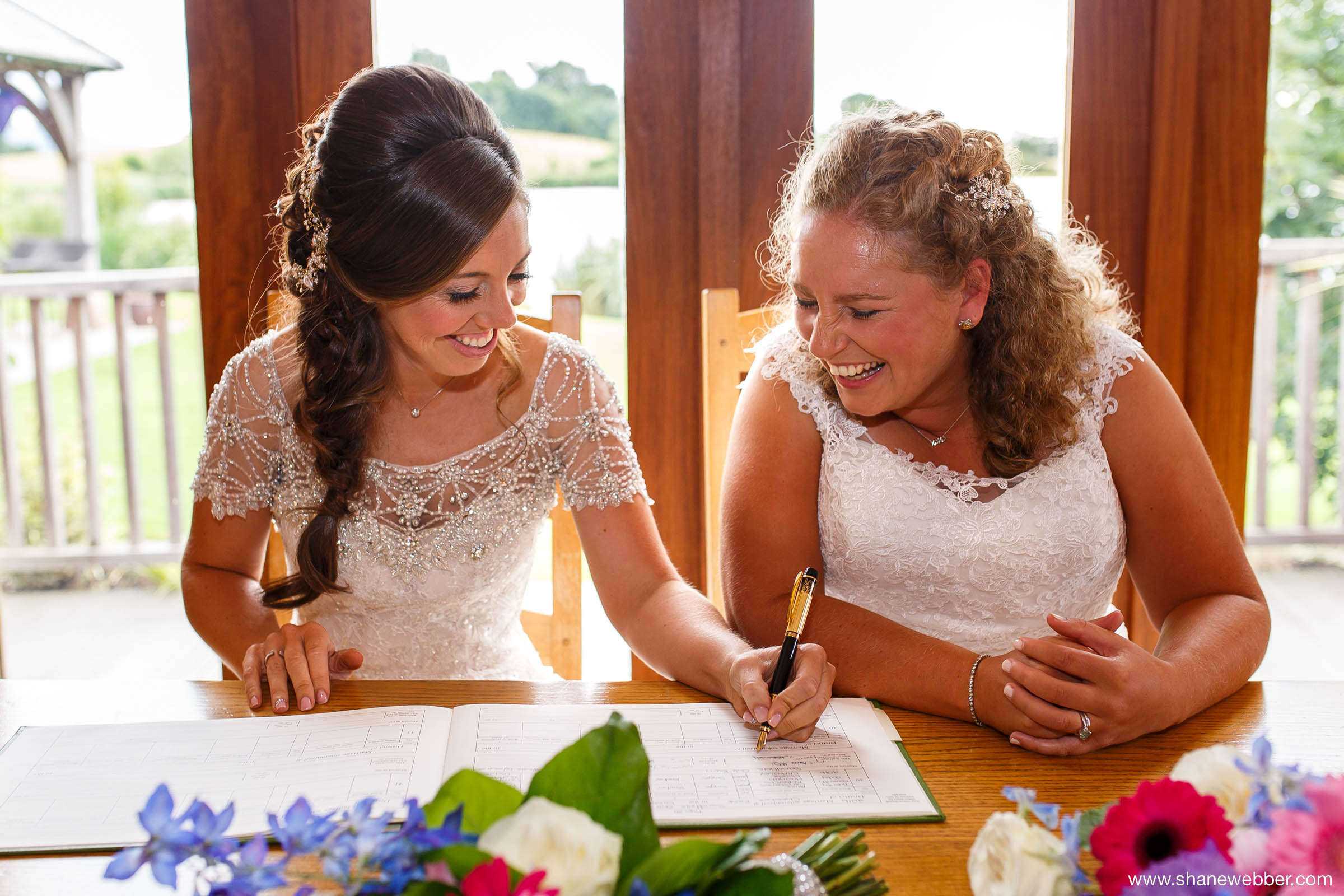 Two brides signing the register