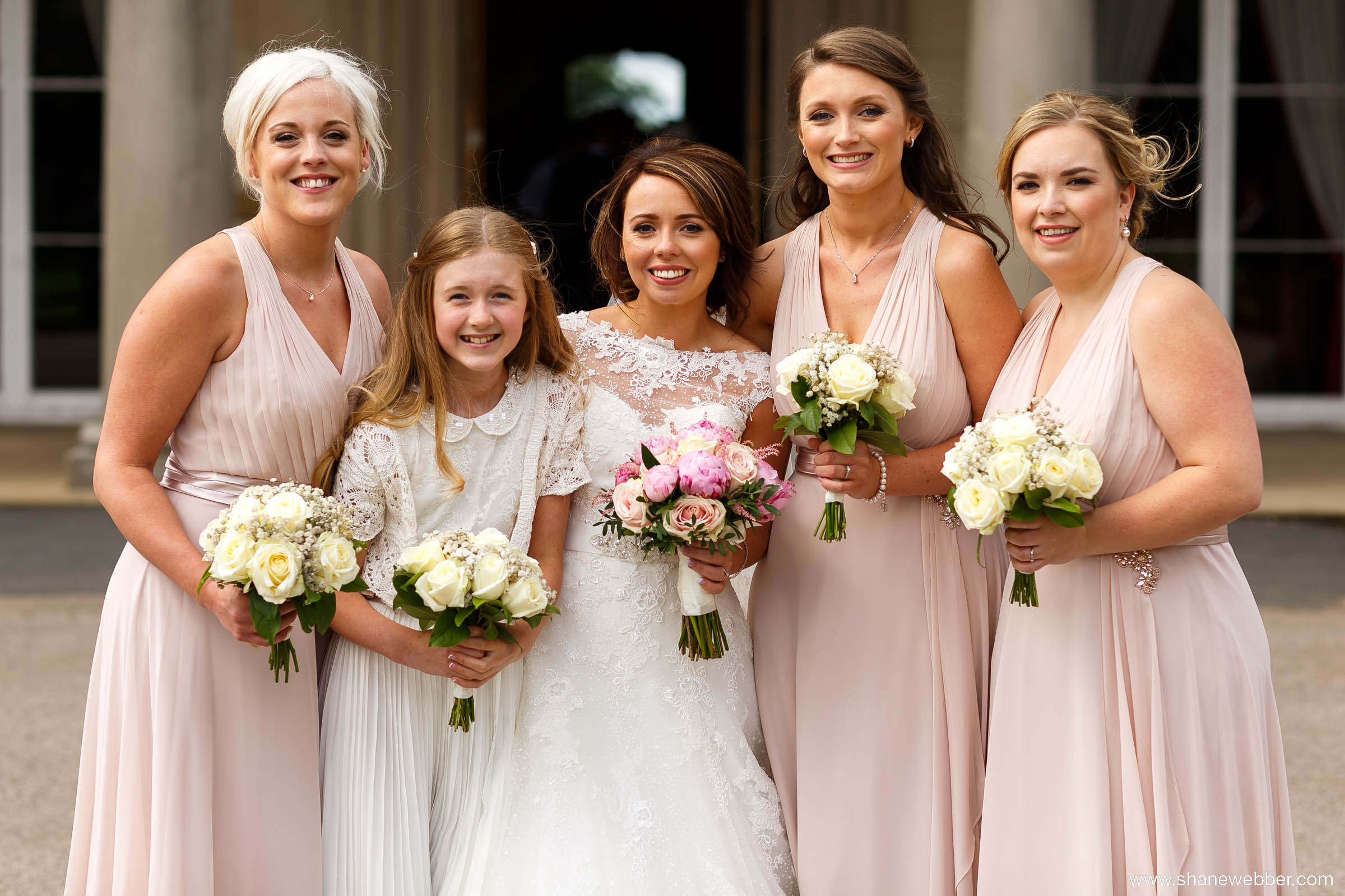 Bridesmaids wearing elegant nude pink dresses