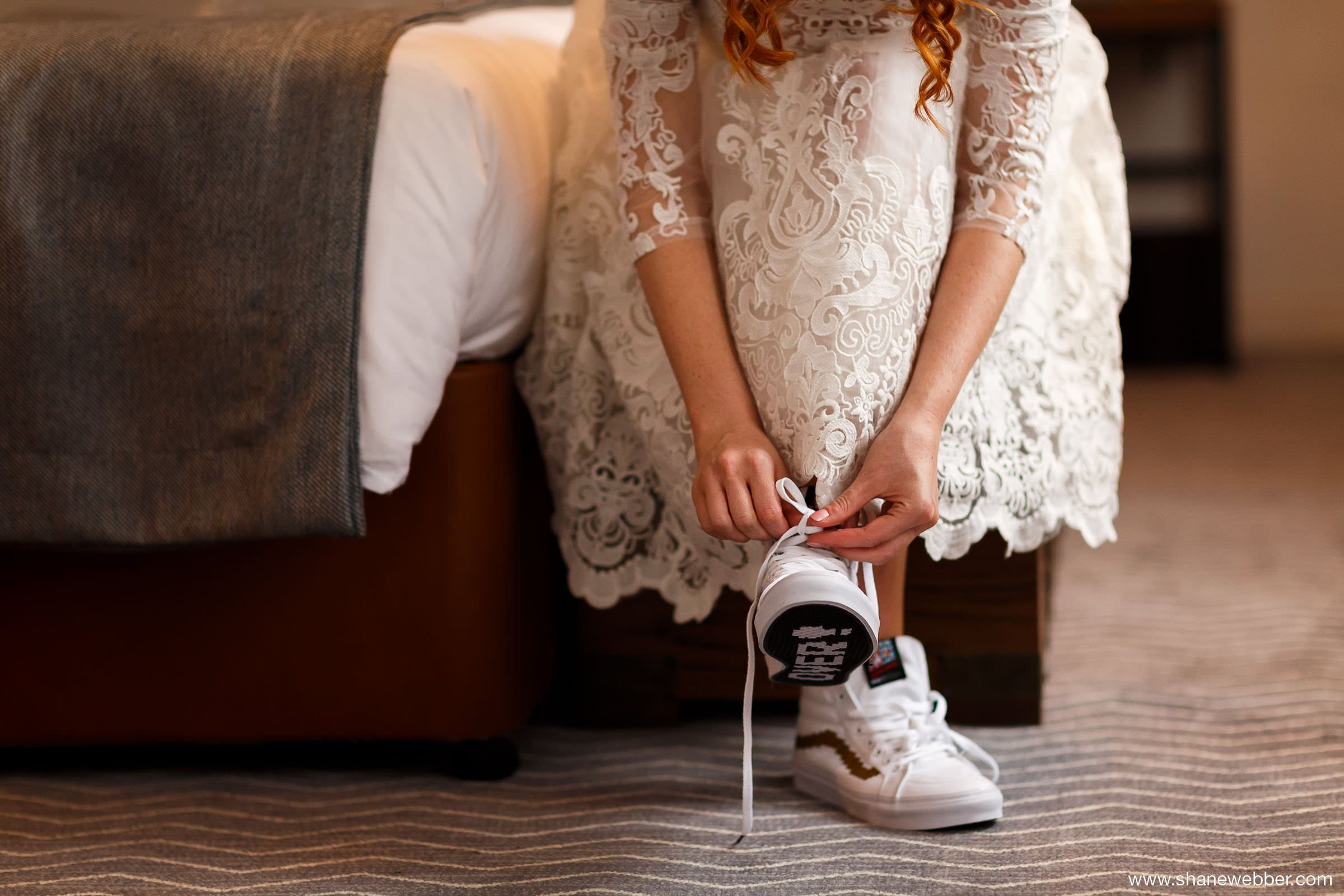 Bride wearing white Vans wedding trainers