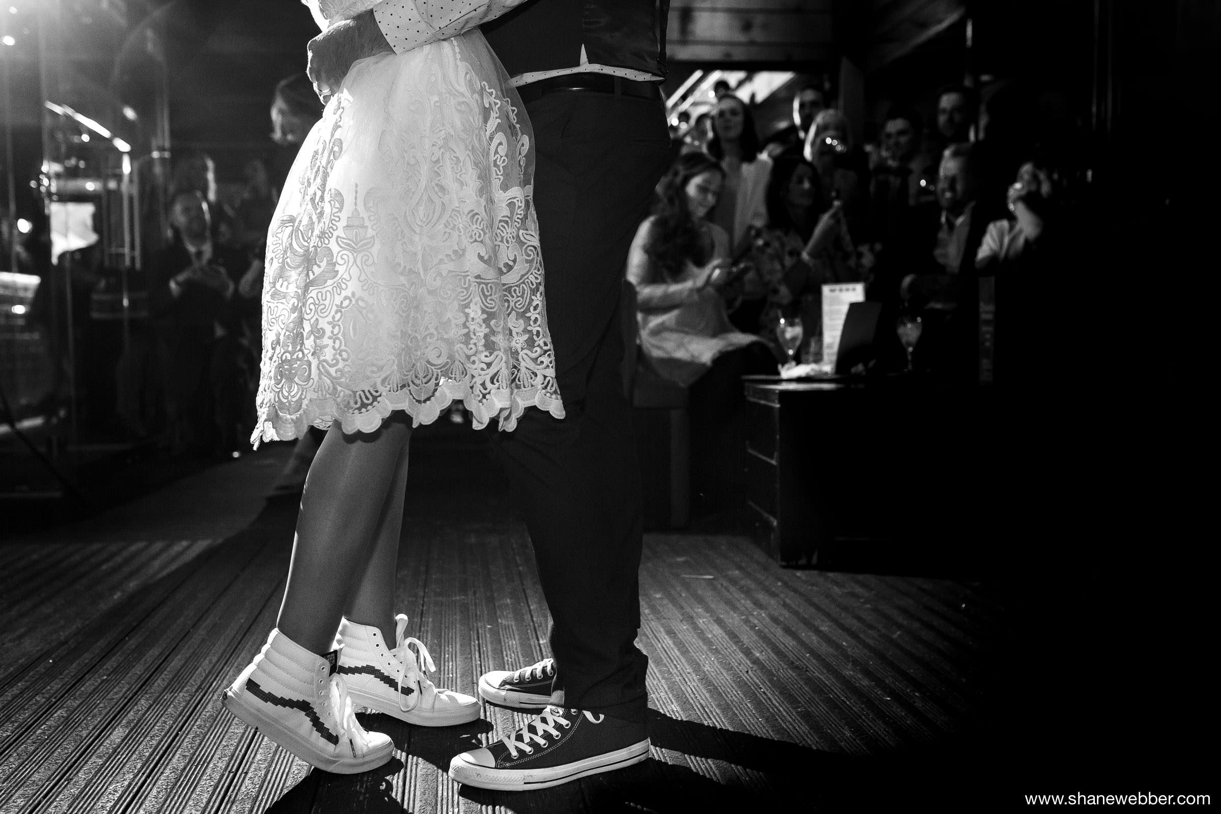 Photo of bride and groom having their first dance