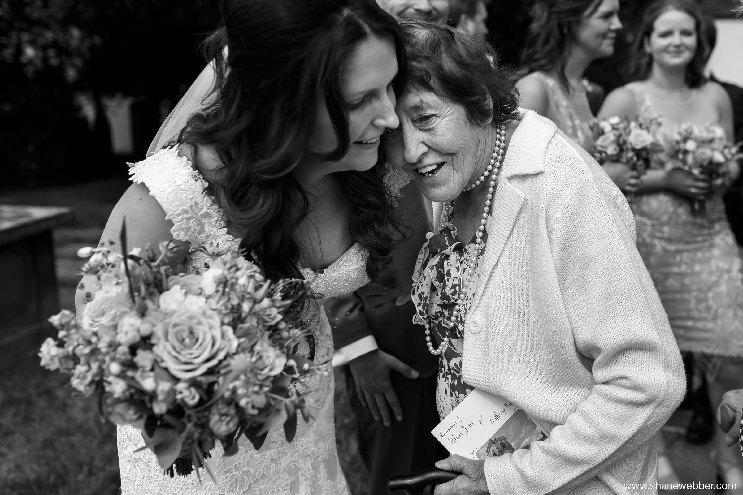 Emotional wedding photo of elderly guest