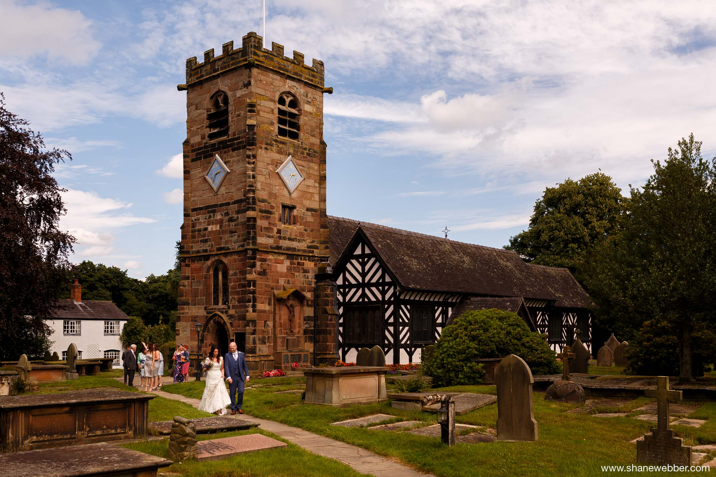 Bride and groom at Saint Oswald's Church in Lower Peover