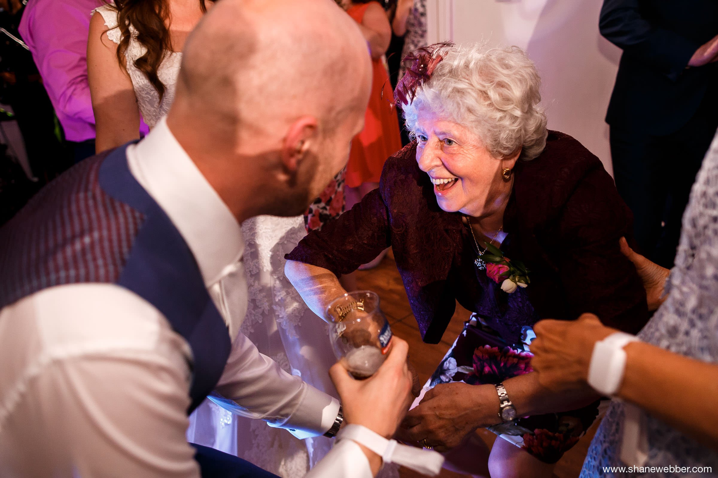 Groom dancing with grandma