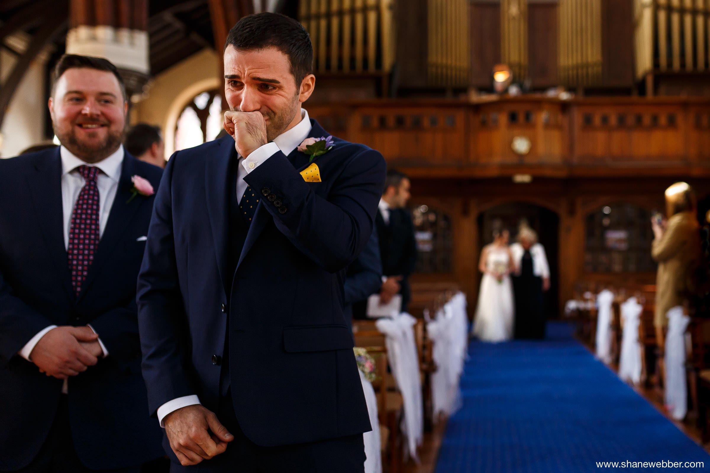 Crying groom at wedding
