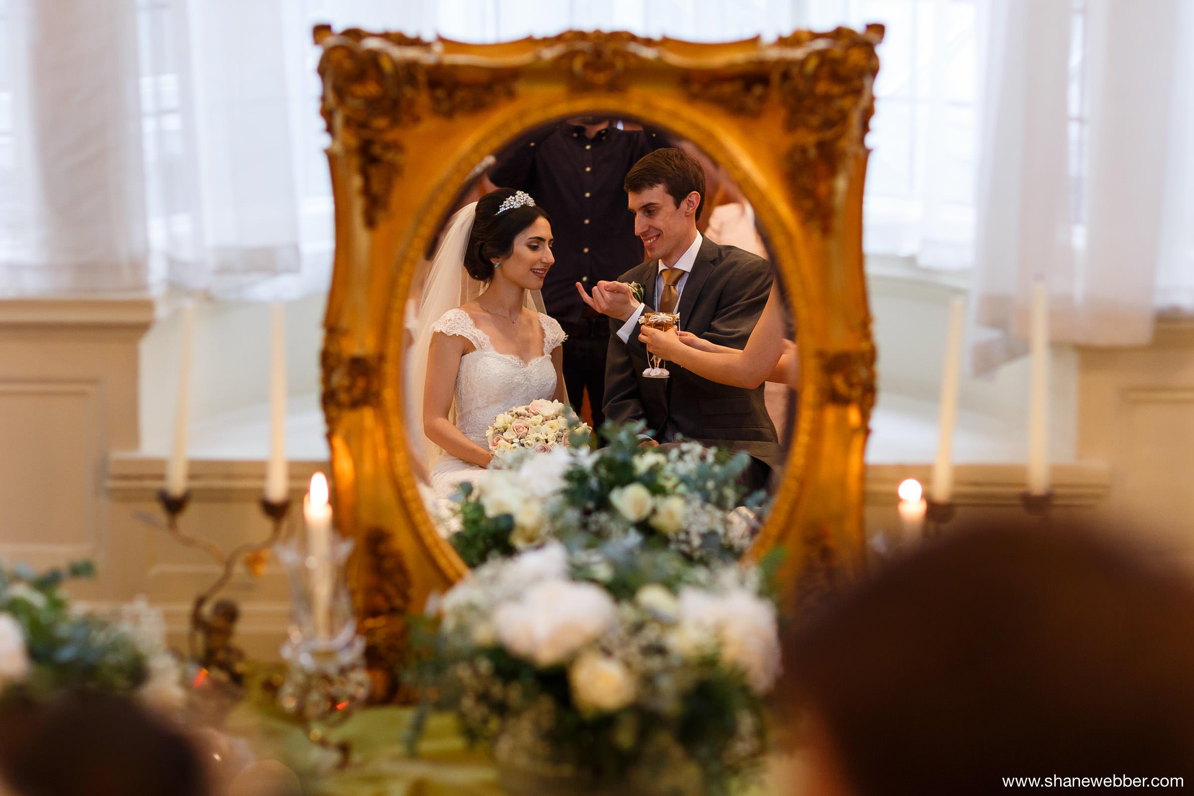 Bride and groom in mirror with Sofreh Aghd