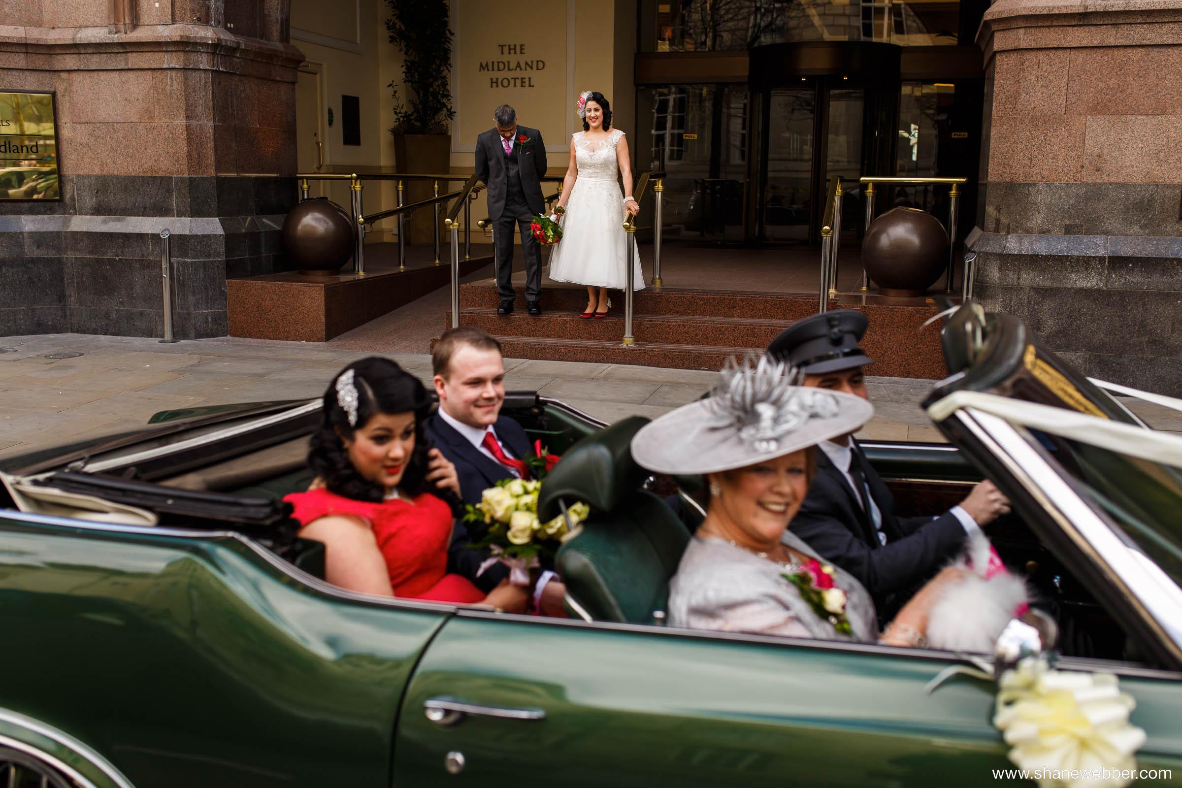 Bride getting into the vintage car