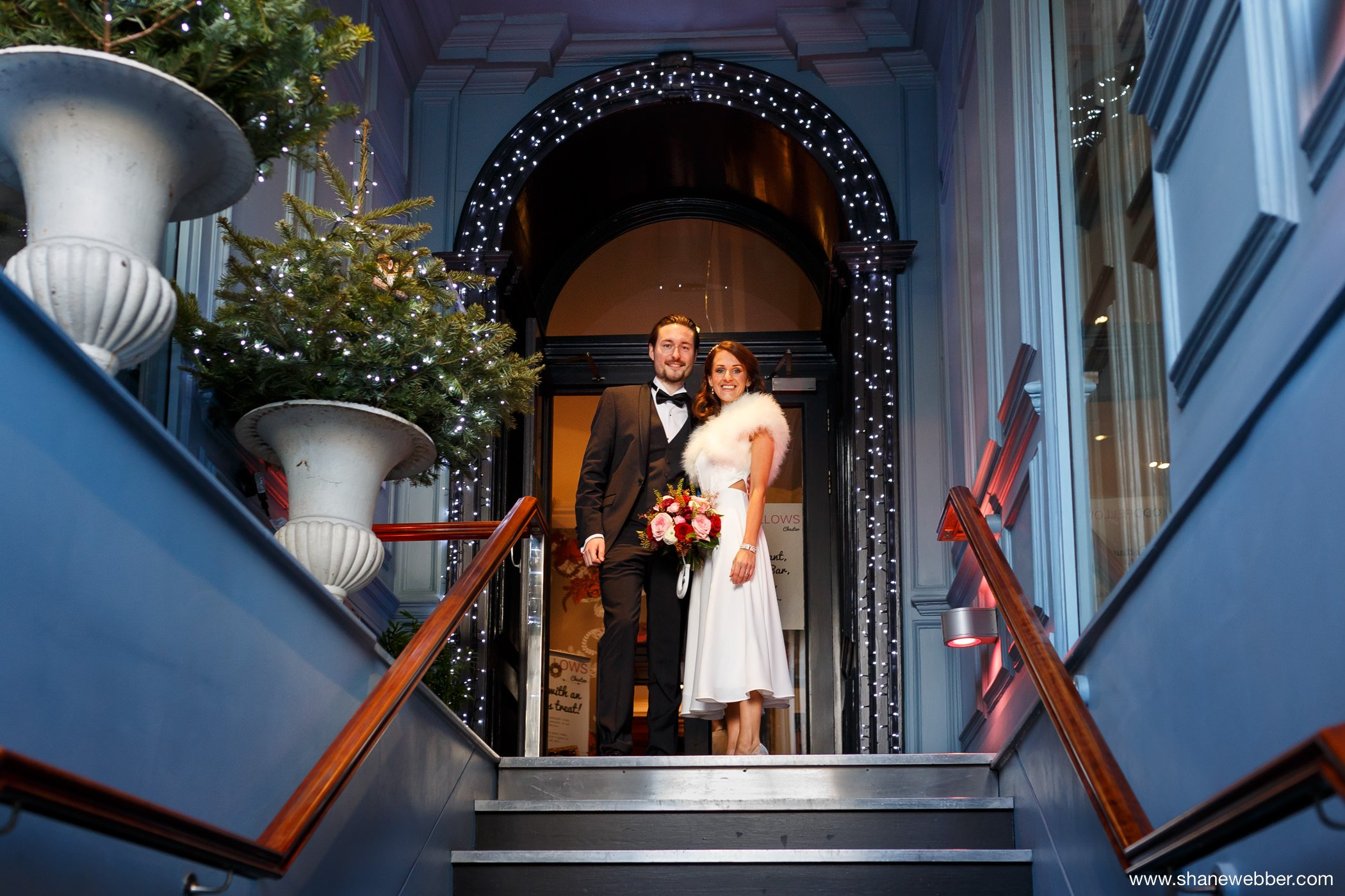 Bride and groom at the entrance of Oddfellows Chester
