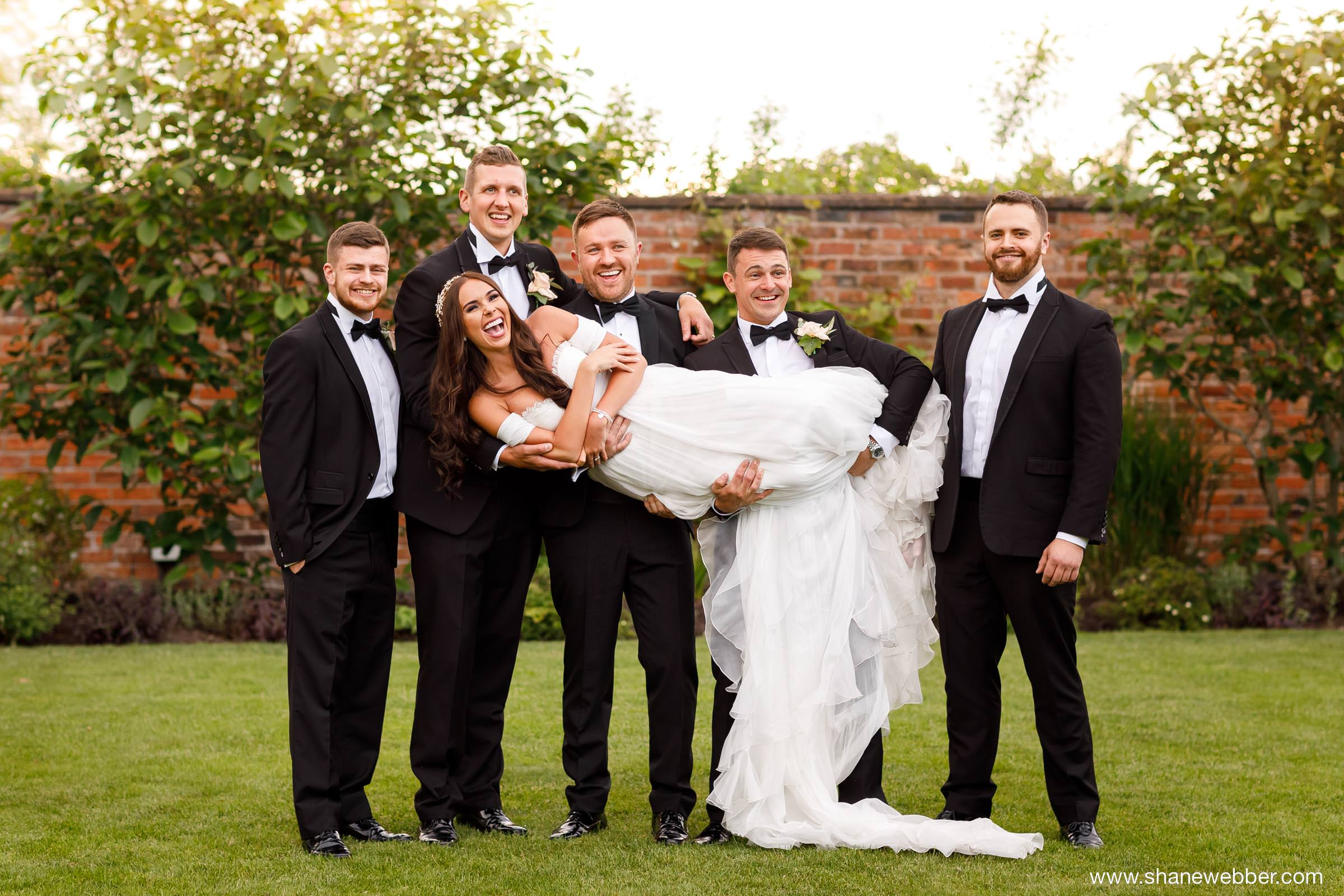Group wedding photos in the garden at Colshaw Hall
