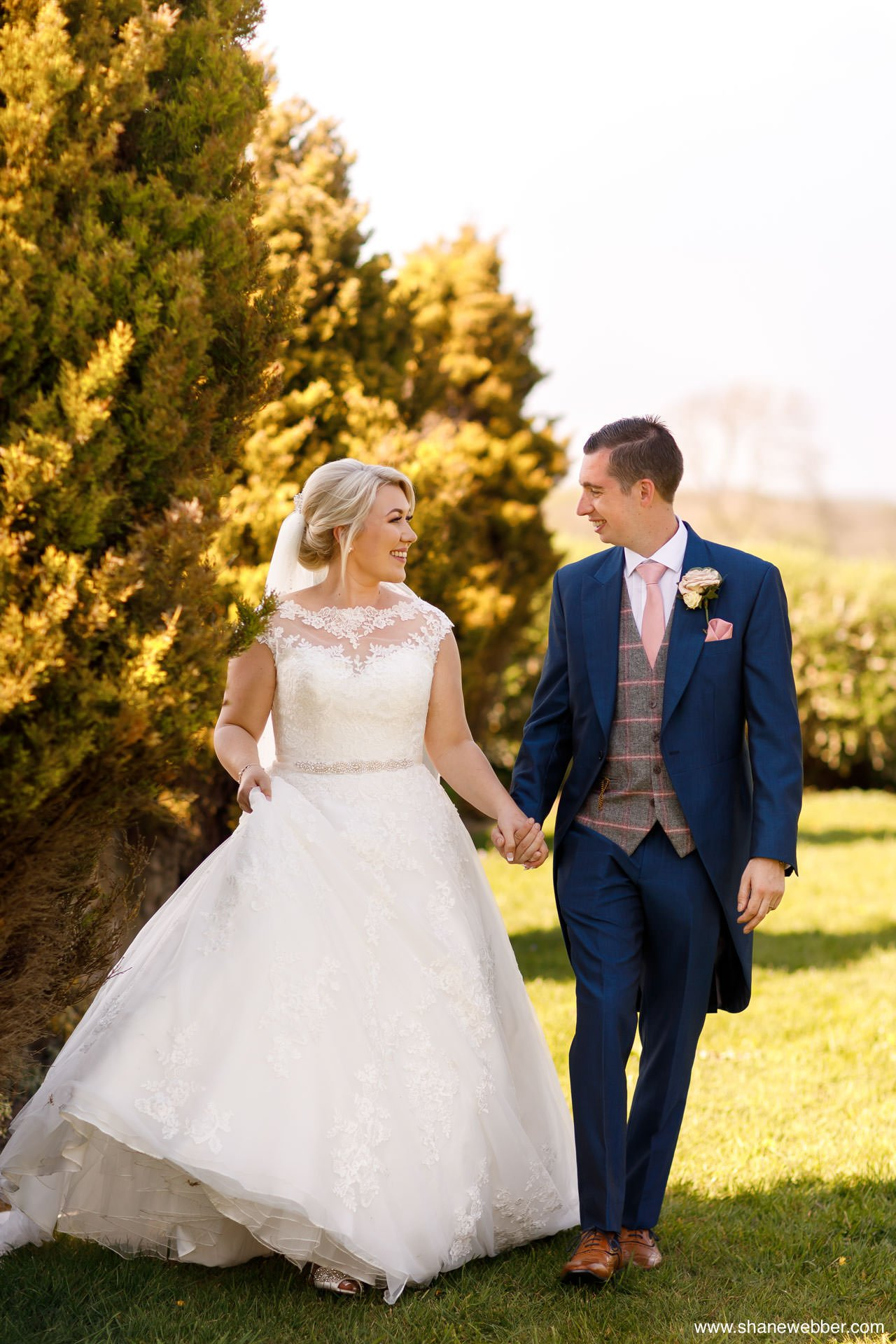 Couples wedding portraits in the Beeston Manor gardens