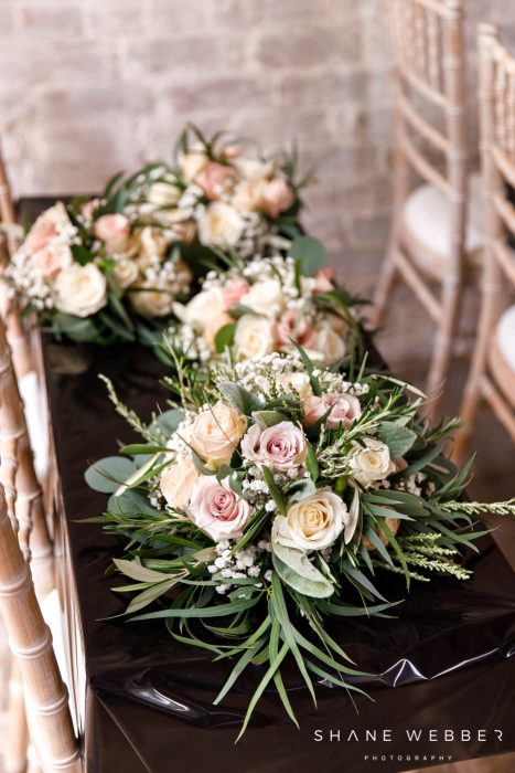 Red floral bouquets at dorfold Hall