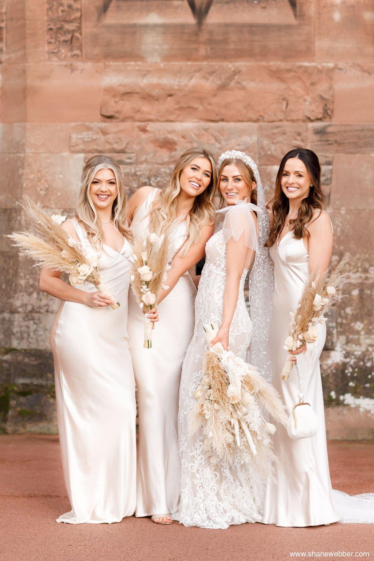 Bridal photo at Peckforton Castle wearing Berta dress