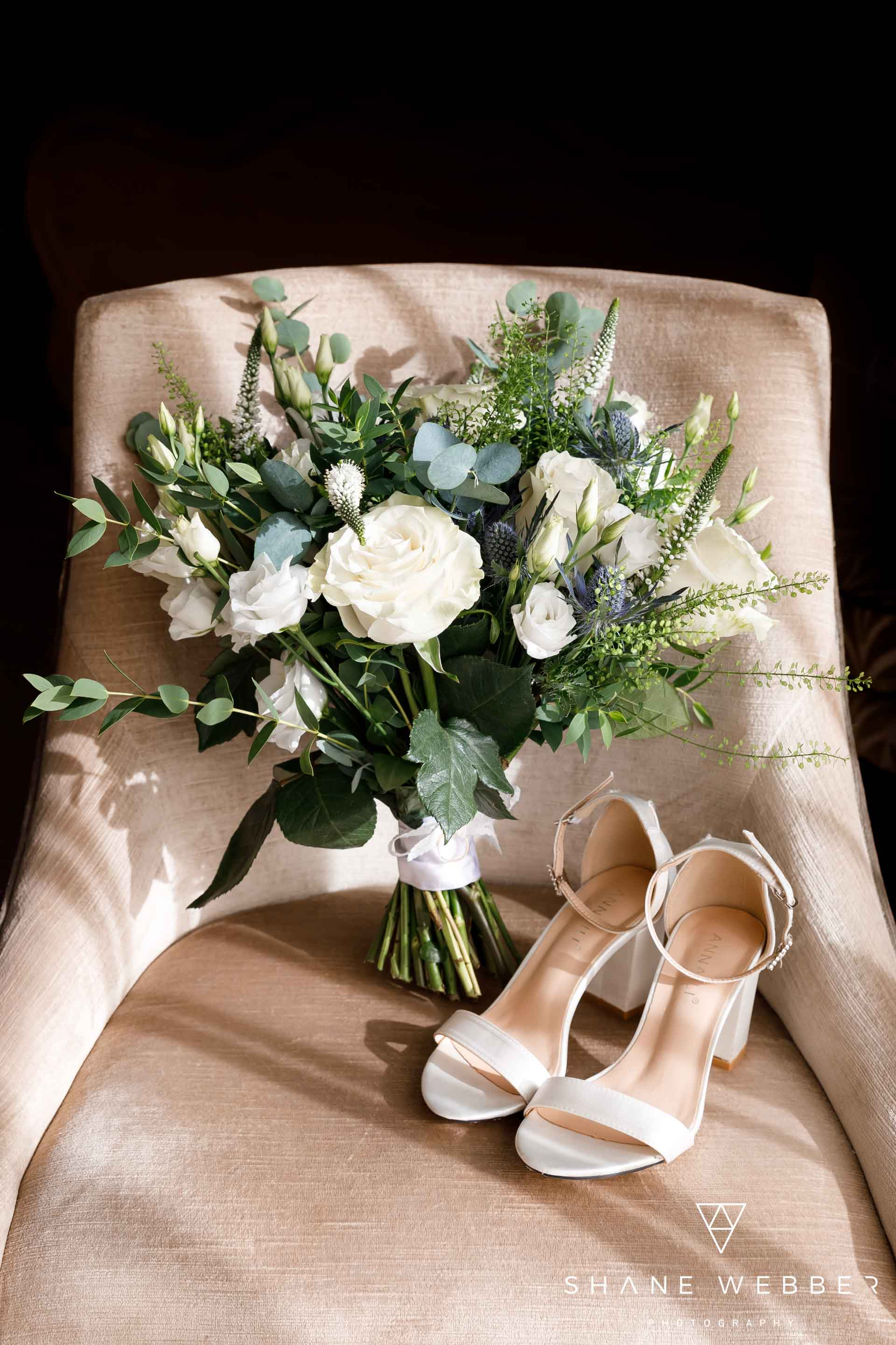 Wedding day shoe and flowers photo