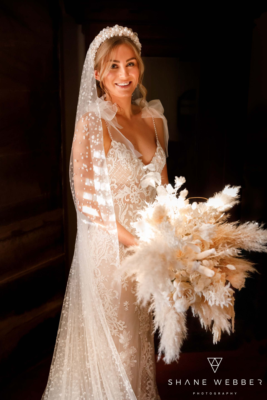 Bride wearing Berta Privee wedding dress with Verdure Floral wedding bouquet