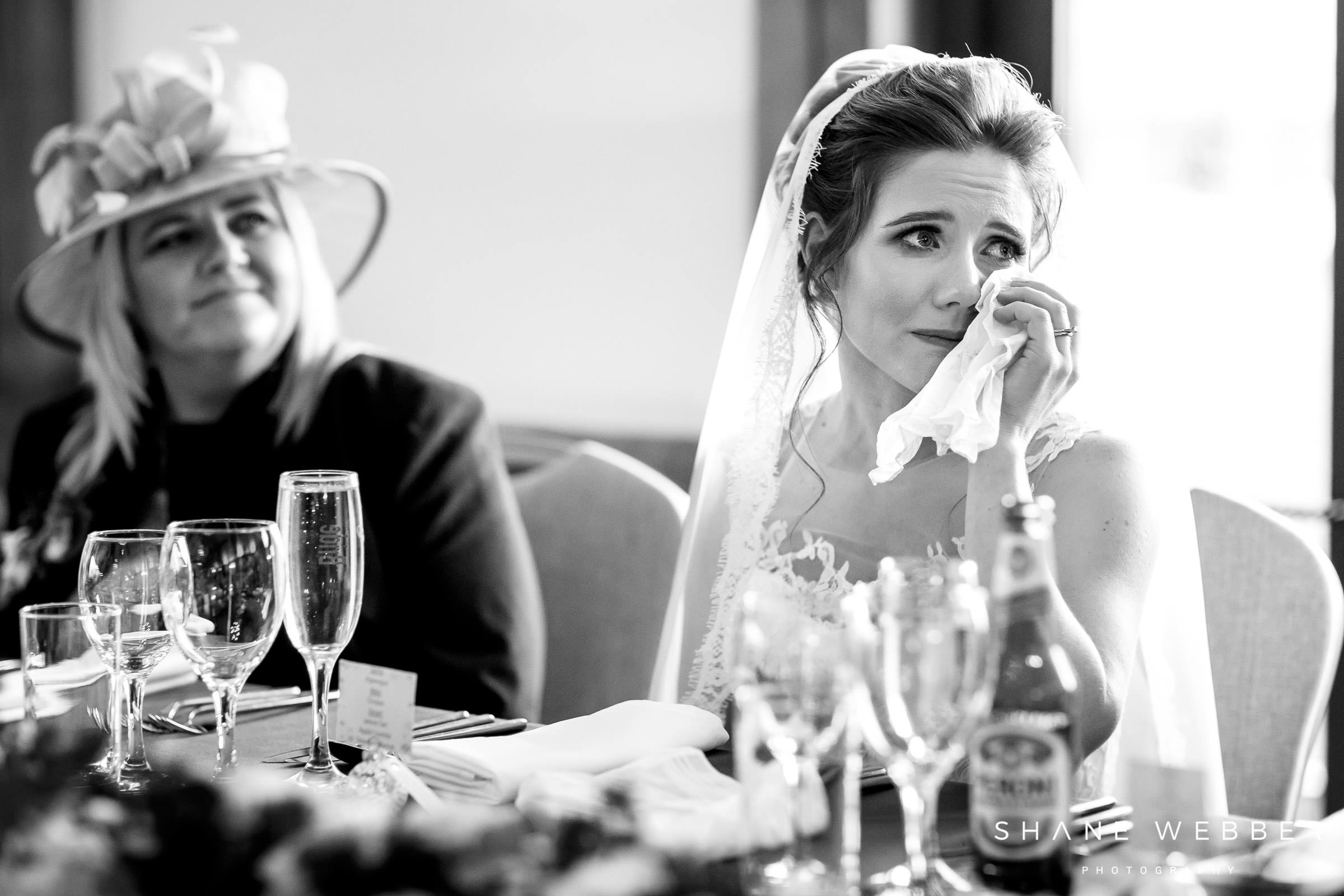 Emotional bride during wedding speeches
