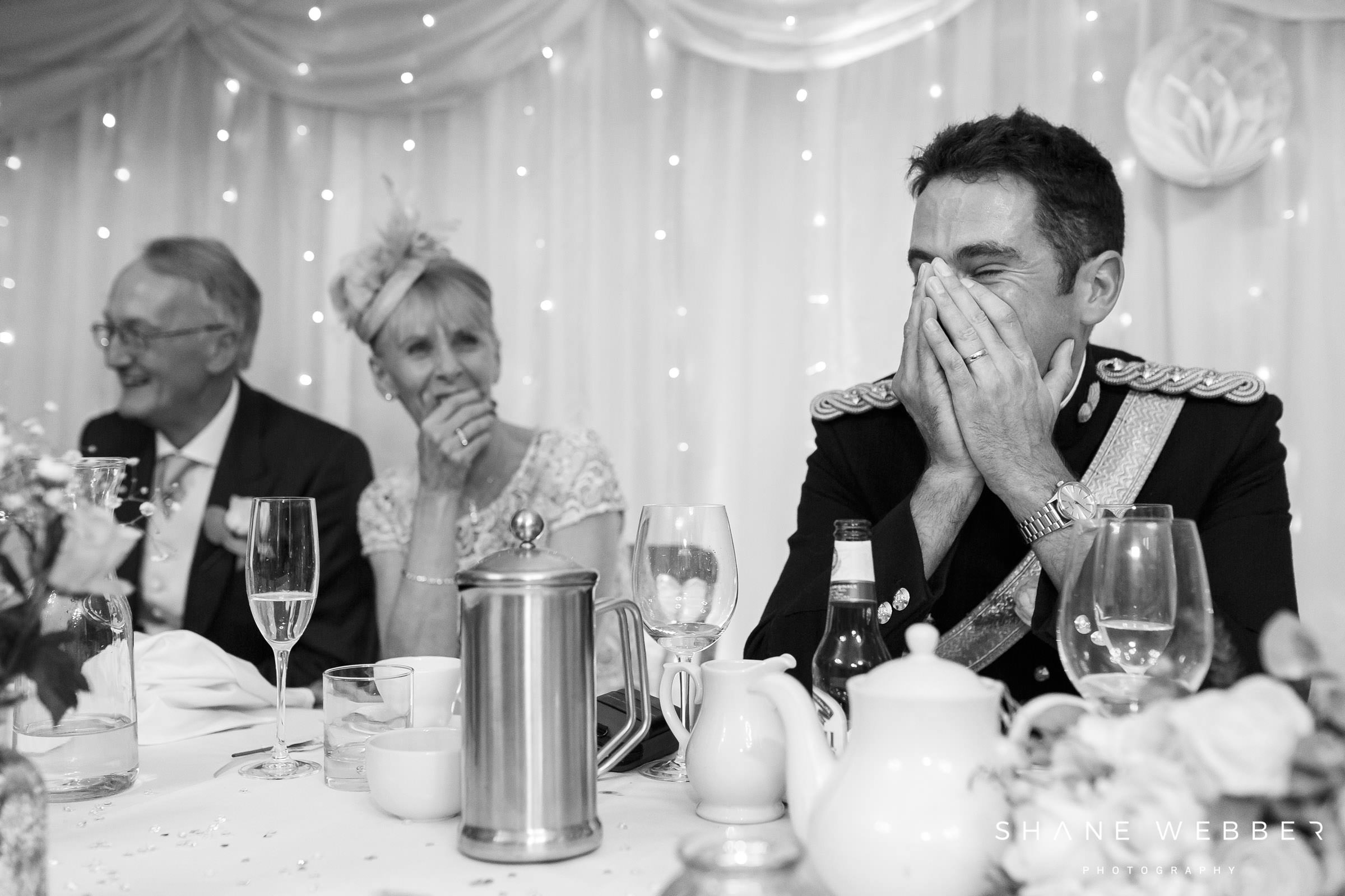 Embarrassed groom during wedding speeches