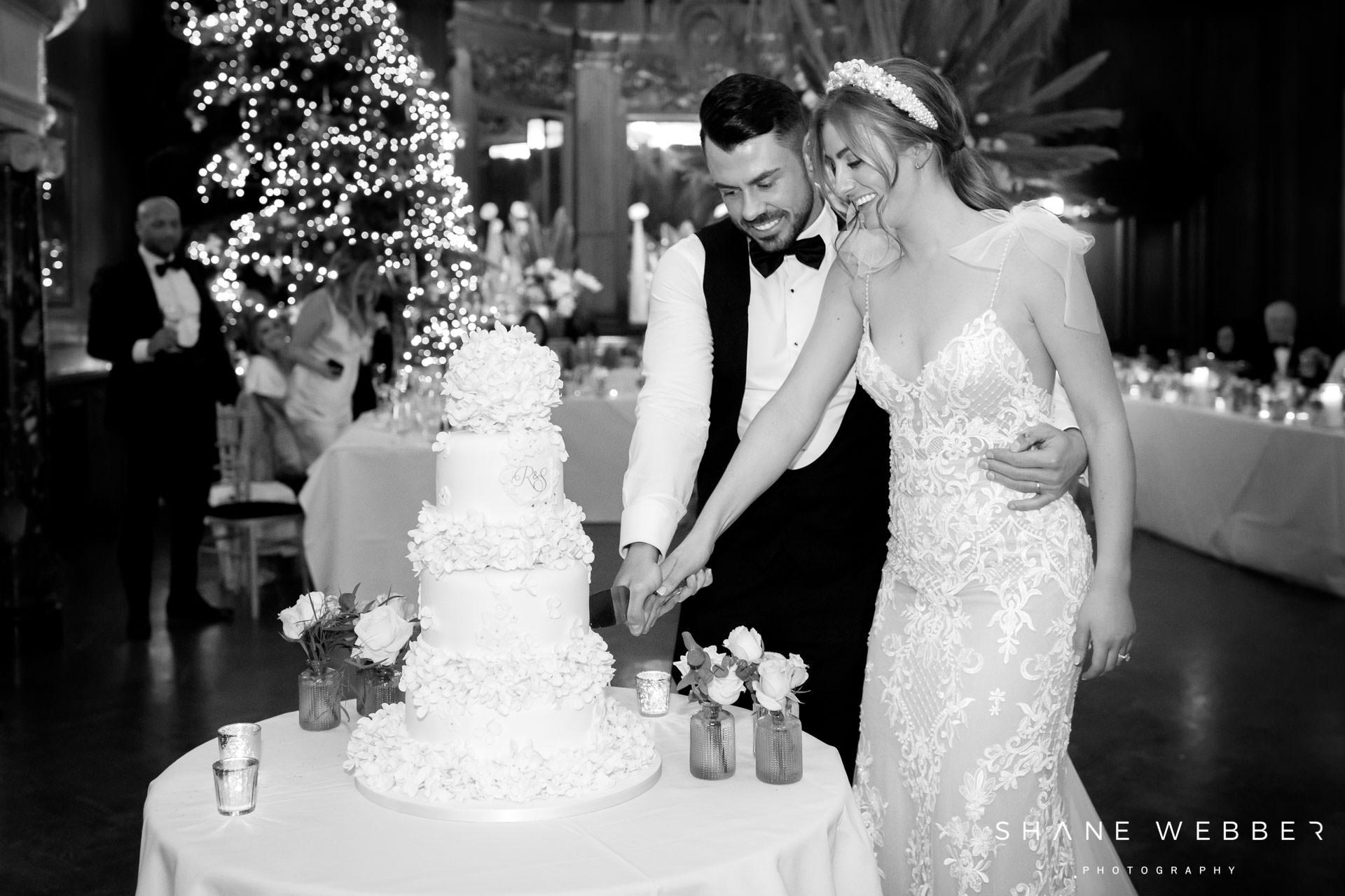 Bride and groom cutting luxury wedding cake