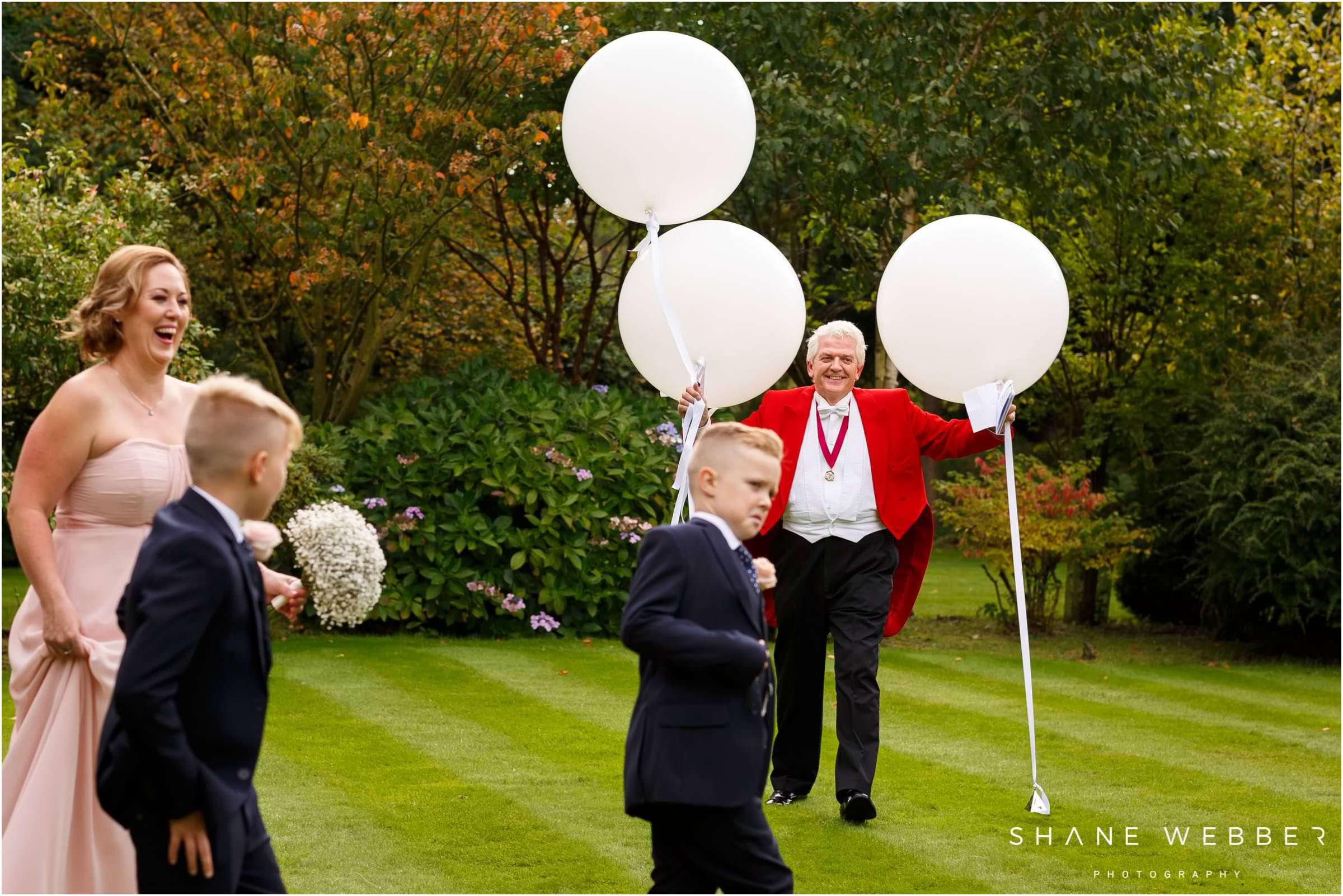 wedding toastmaster holding balloons