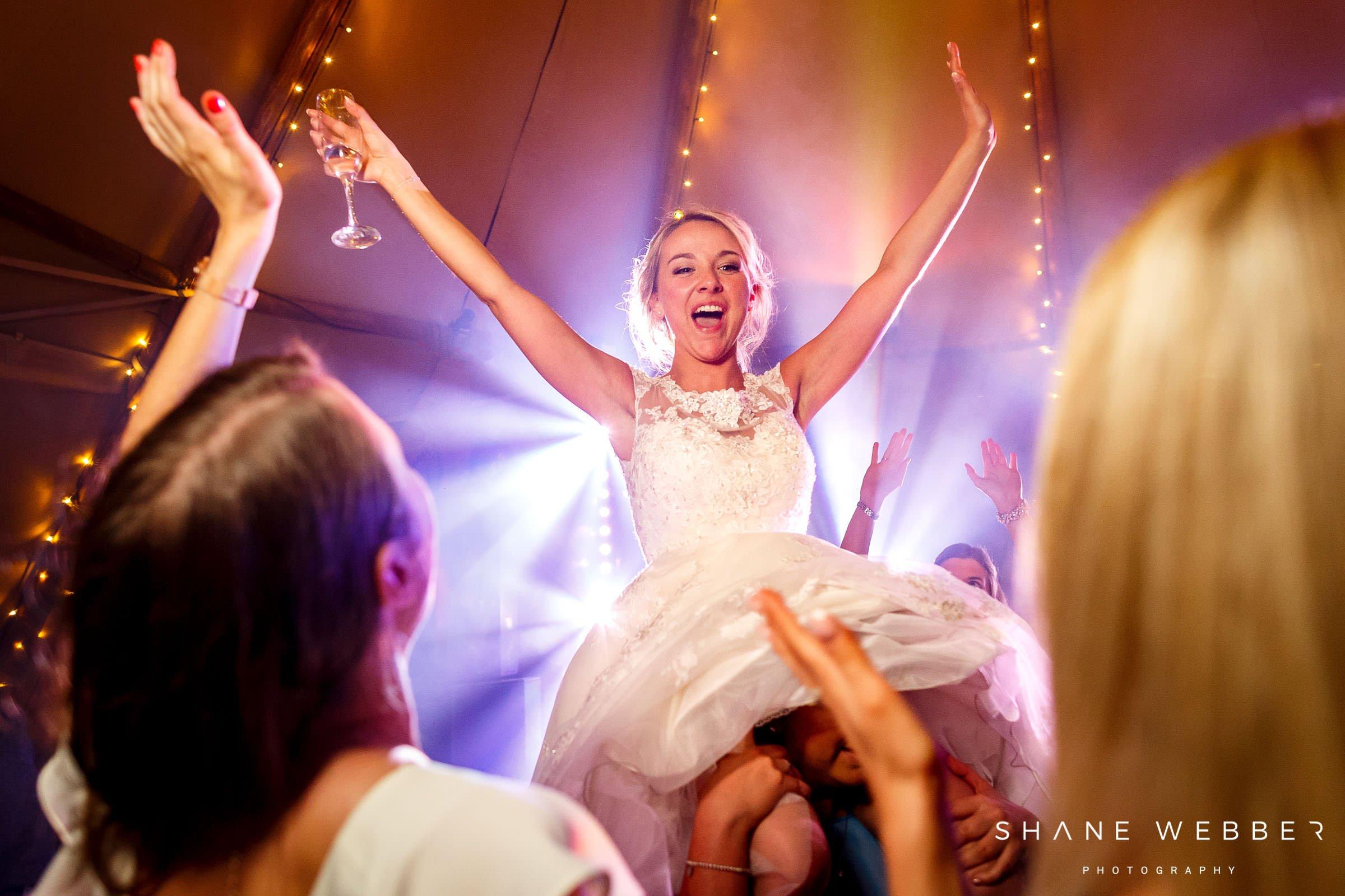 bride celebrates wedding party in tipi