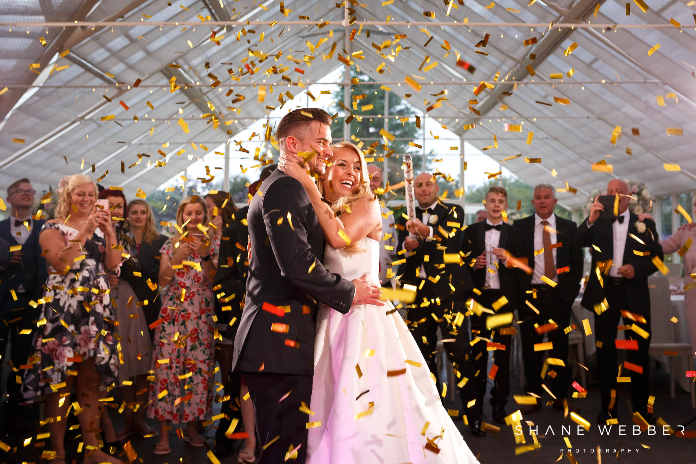 gold confetti cannon during first dance