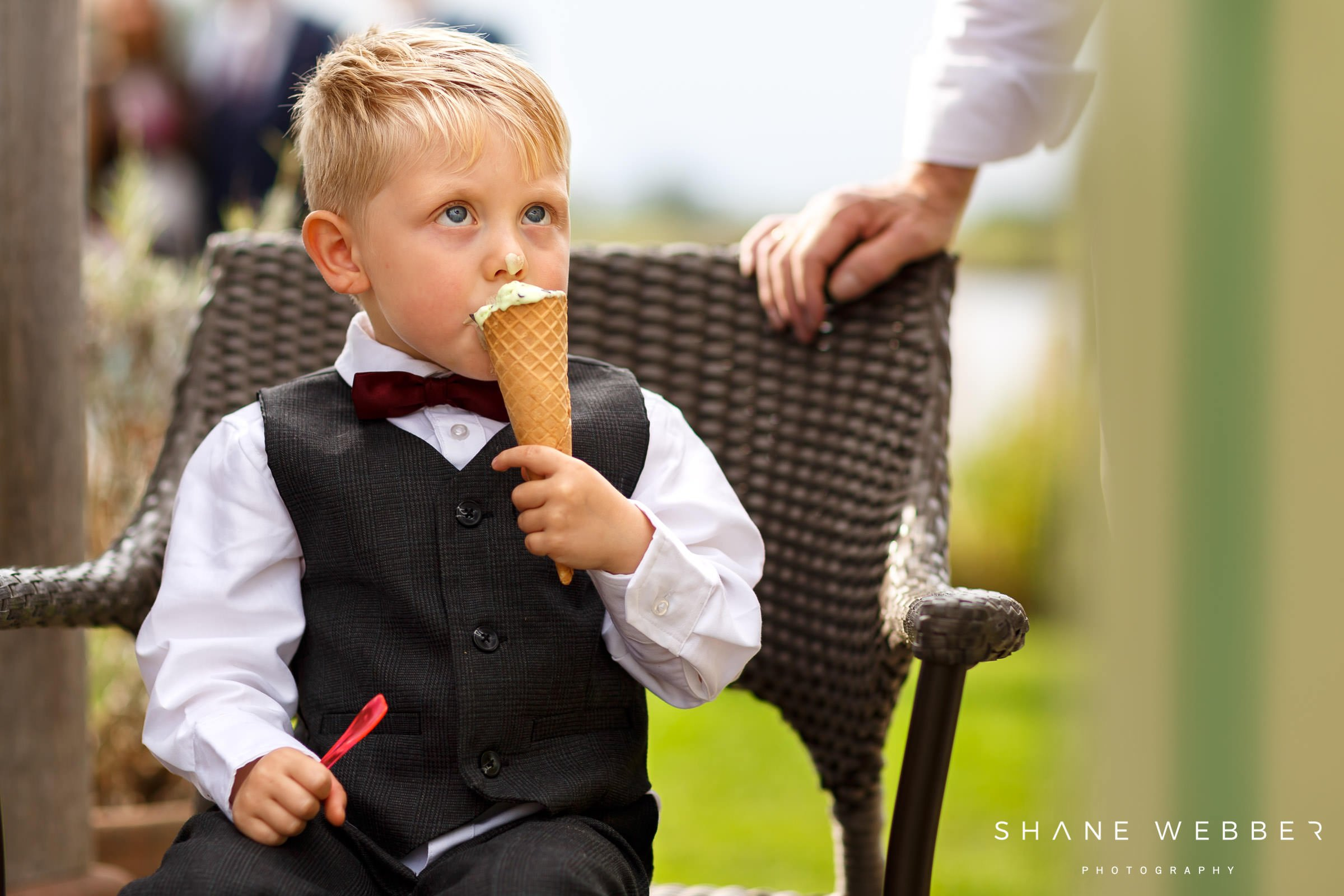 paige boy eats ice cream at wedding