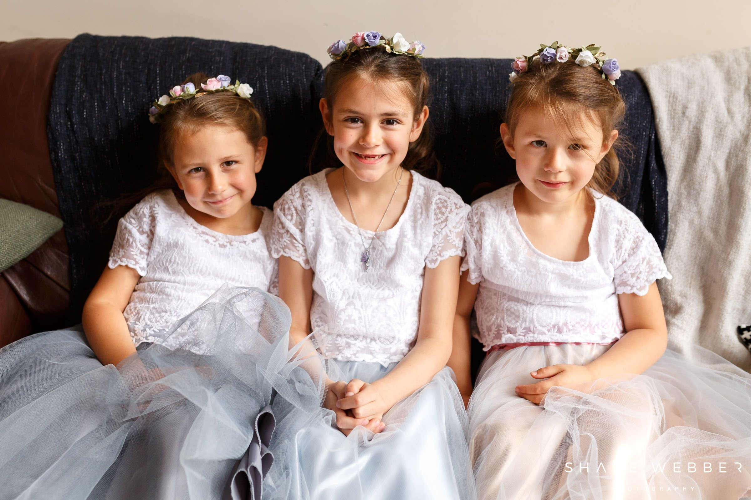 flower girls with hair garlands