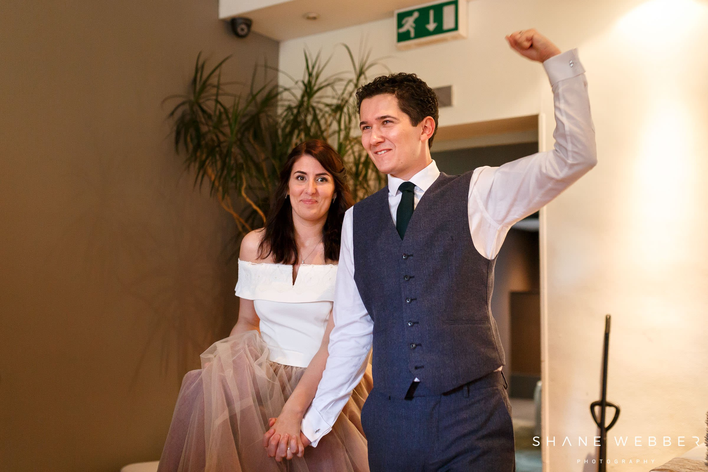 bride and groom entering reception
