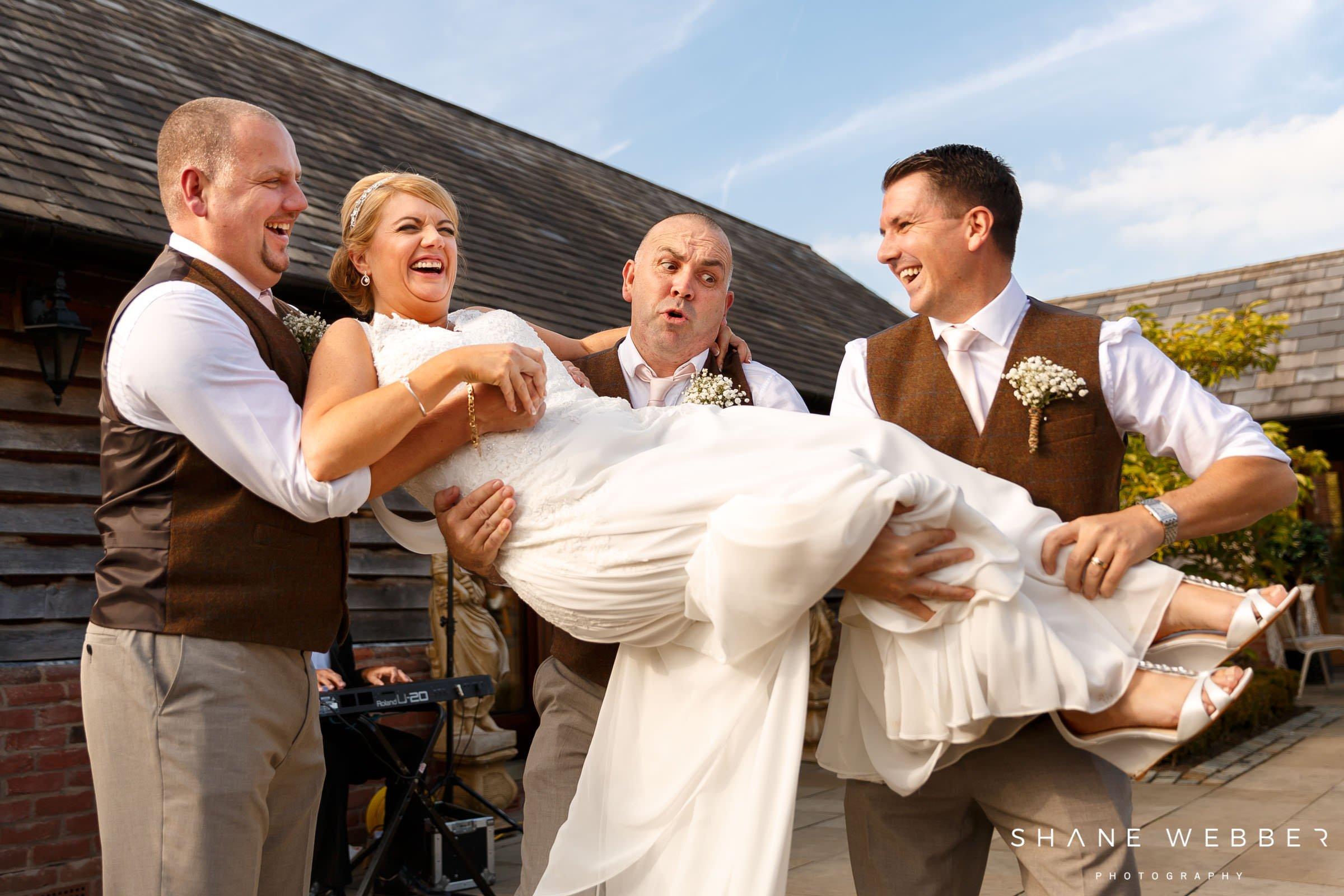 picking up bride wedding photos