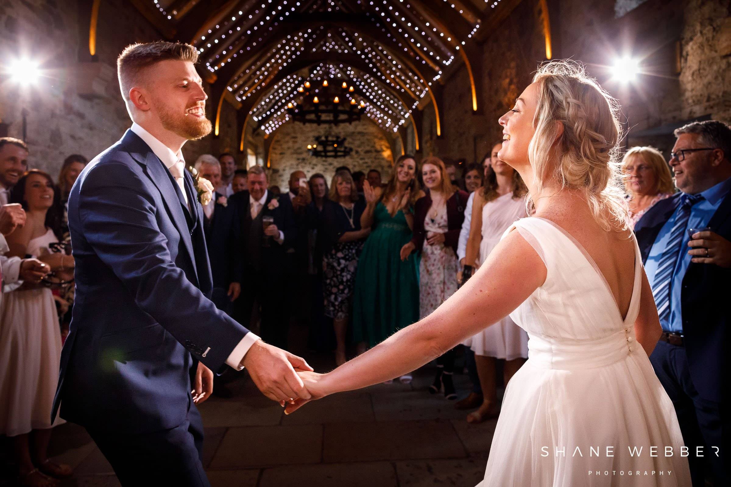bride and groom sharing first dance in the wedding barn in healey