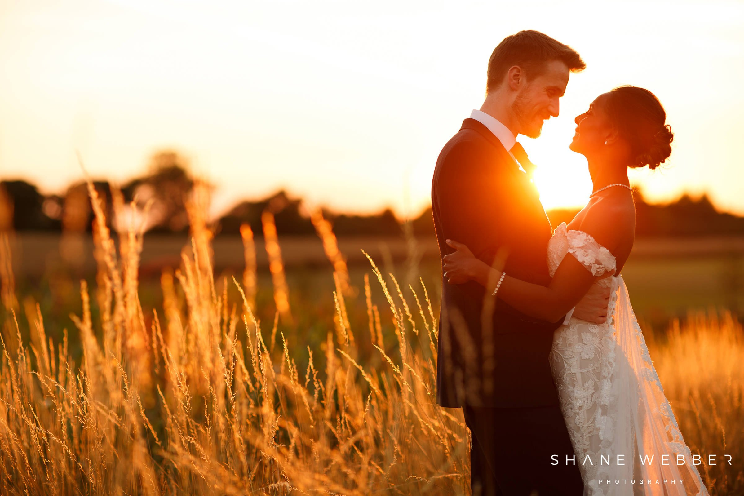 sunset wedding portrait of bride and groom at sandhole oak barn cheshire