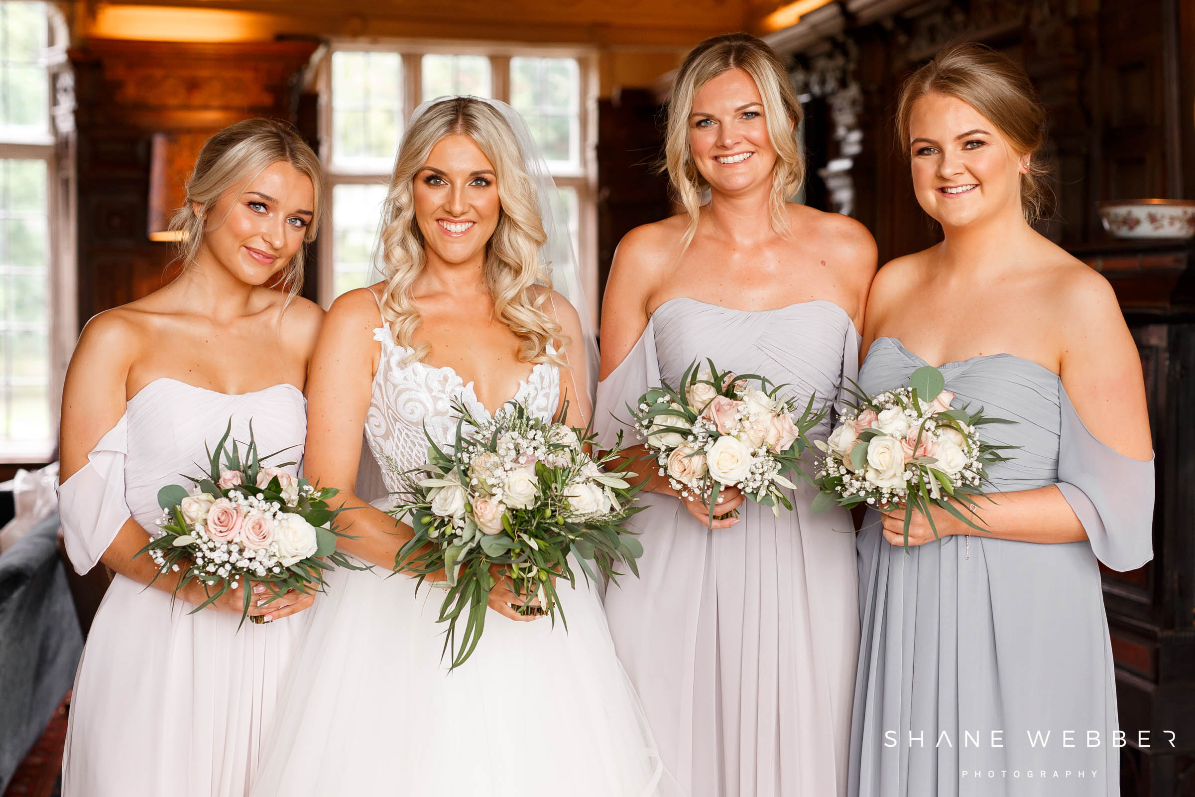 bridesmaids at dorfold hall red floral wedding flowers