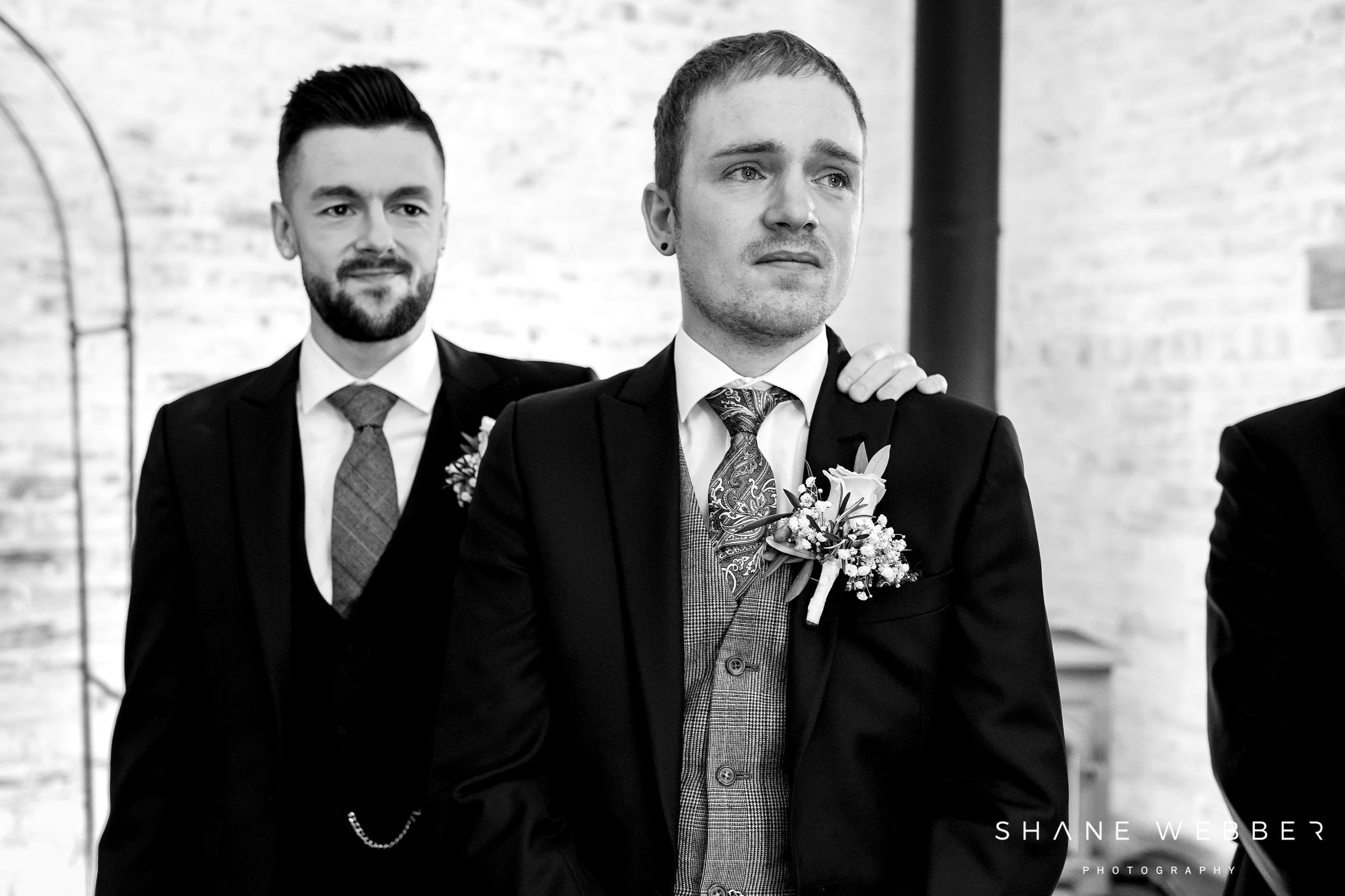 emotional black and white photo groom wedding day