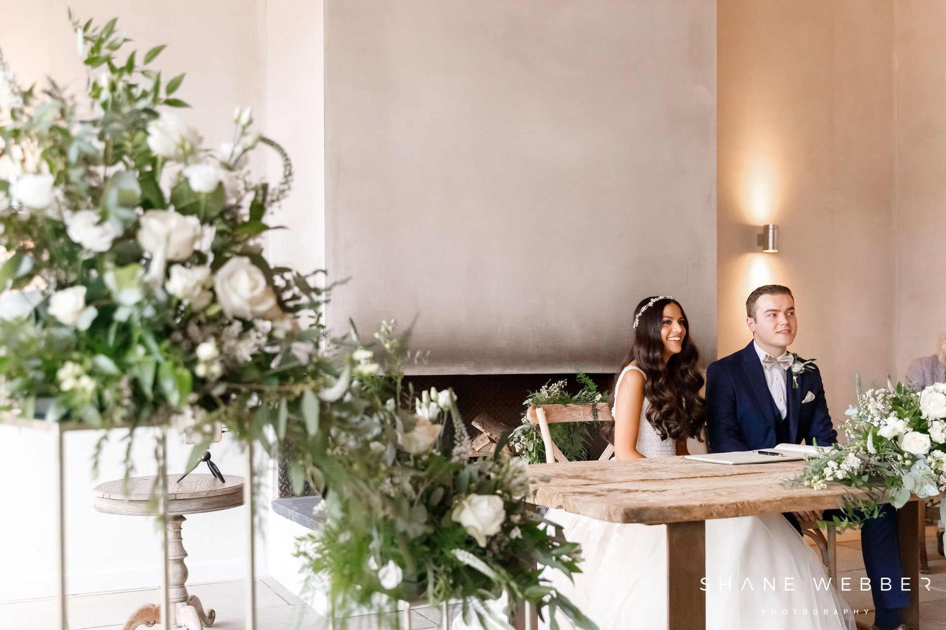 Signing the register at Thorpe Garden wedding