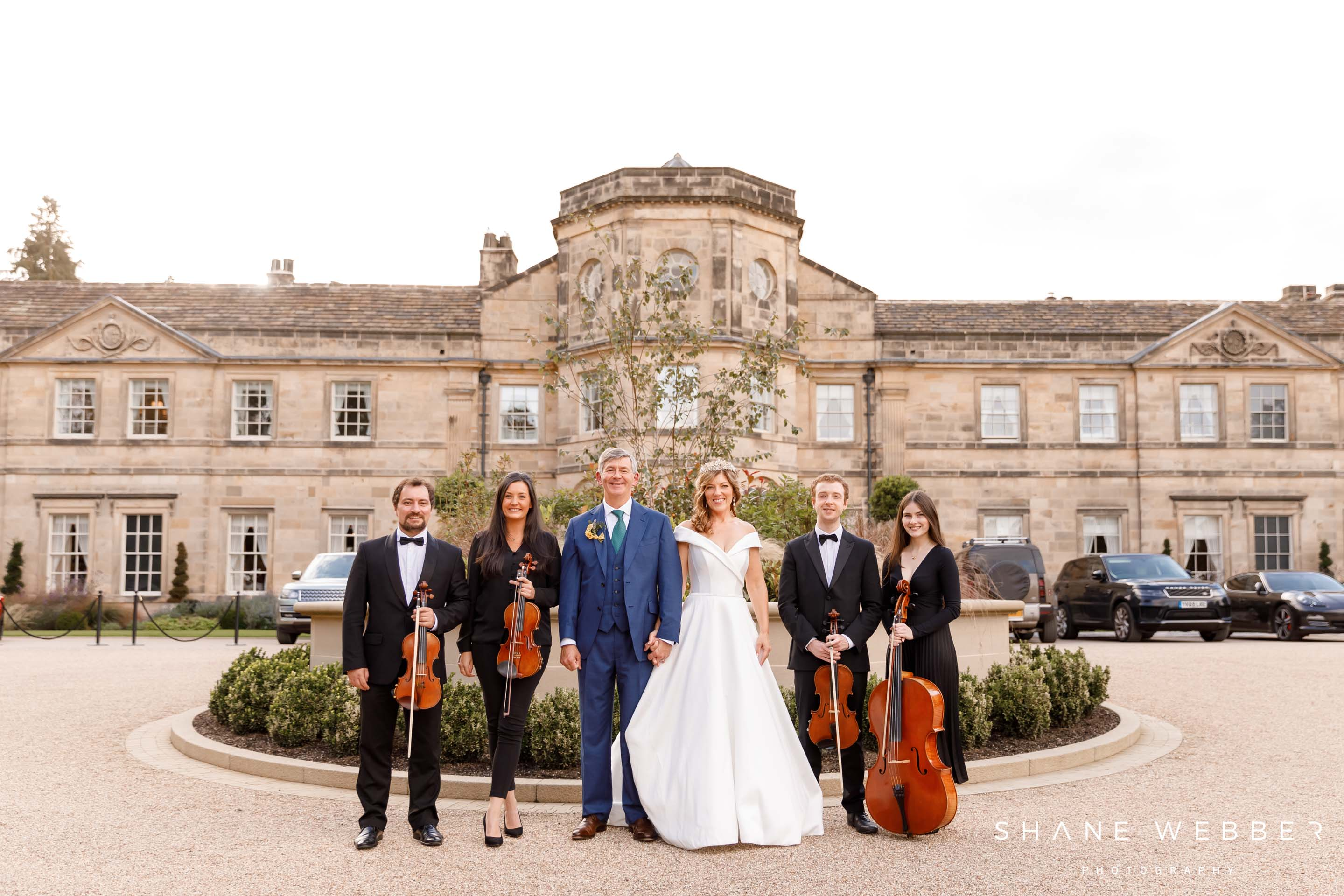 Northern string quartet outside Grantley Hall wedding