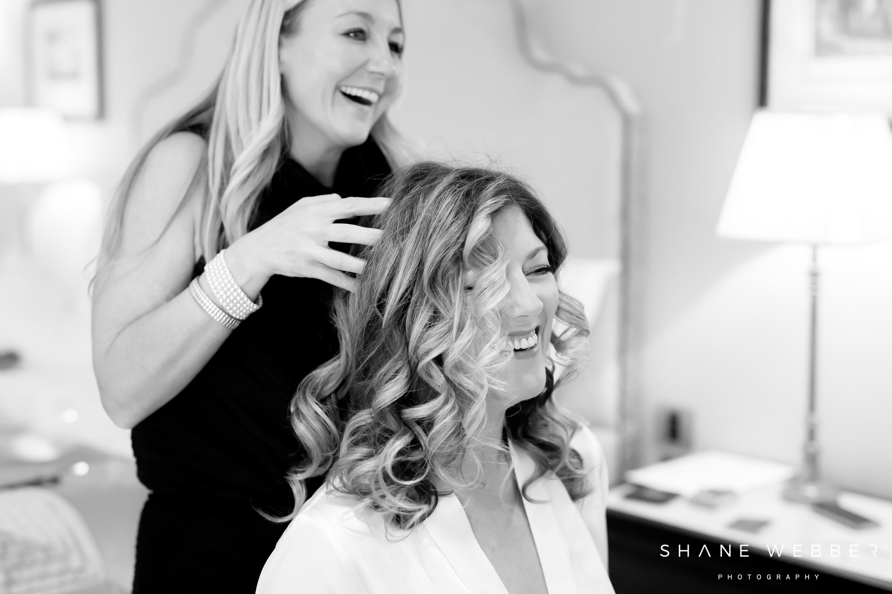 Hairstylist finishing touches during bridal preparation at Grantley Hall